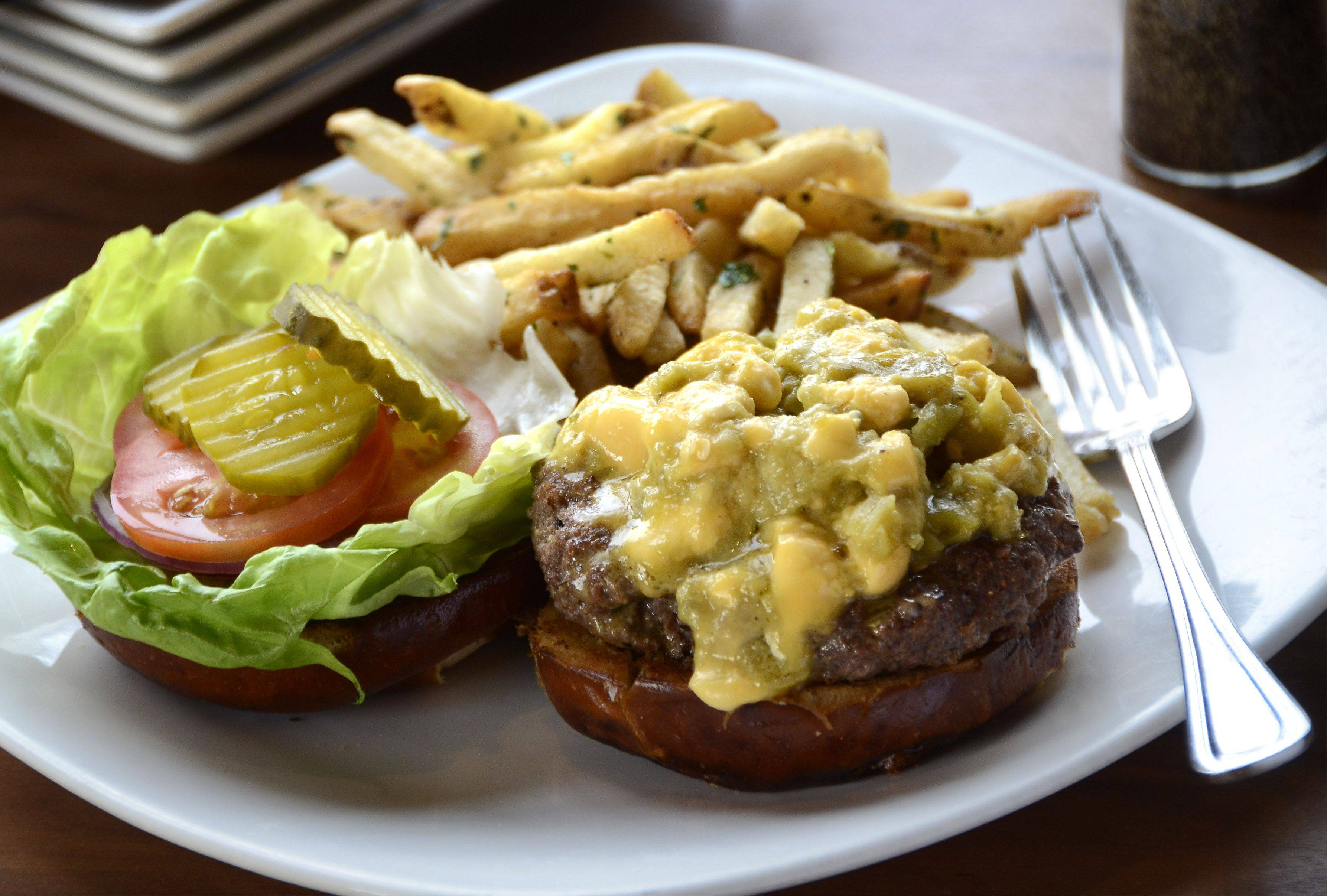 The Green Chili Burger comes stuffed with green chiles and cheese curds at Park Tavern in Rosemont.