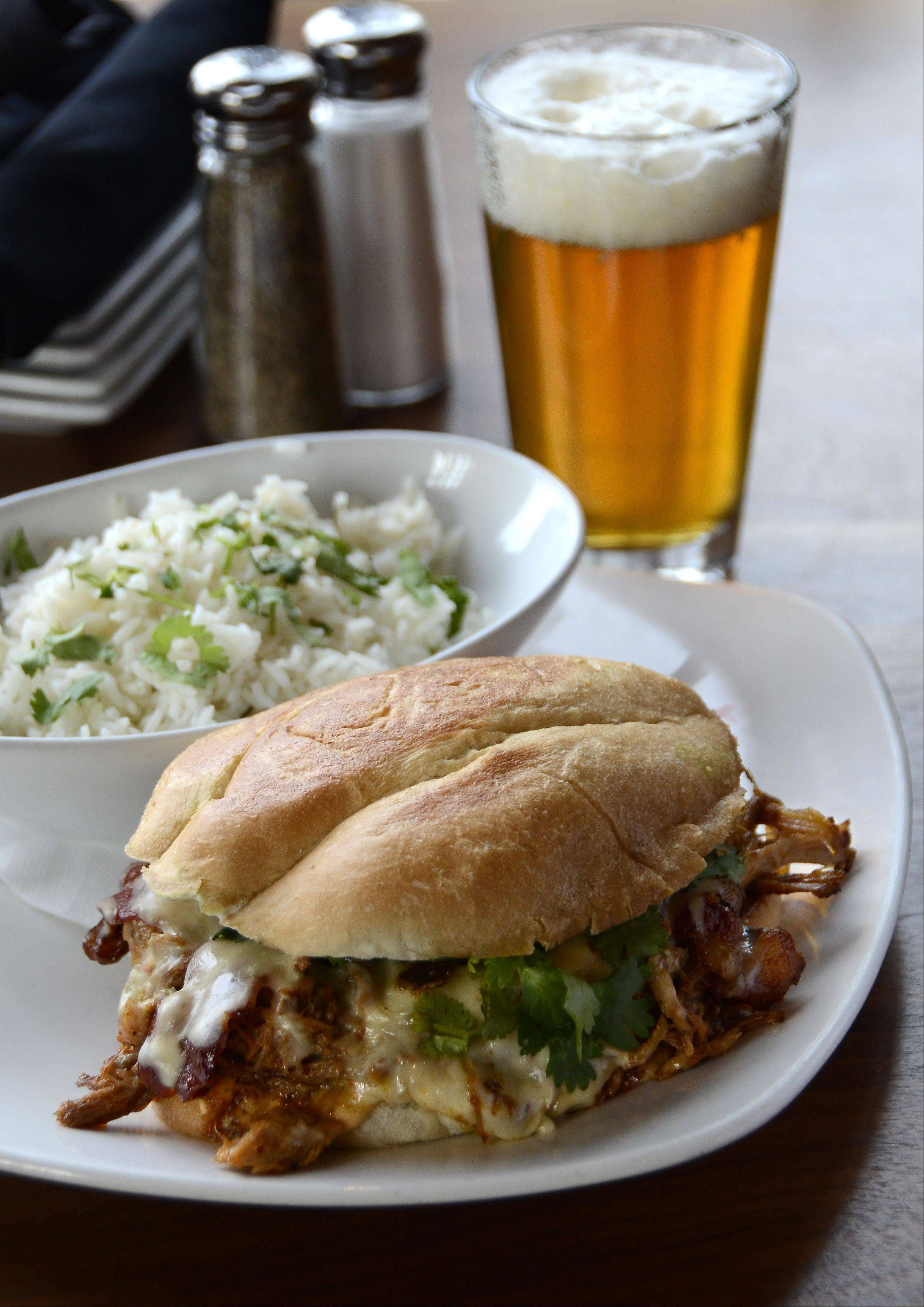 Park Tavern's Mexibano sandwich features spiced pulled pork, Applewood bacon and chihuahua cheese. Served with cilantro-studded rice and a crisp wheat beer, it's a perfect meal.