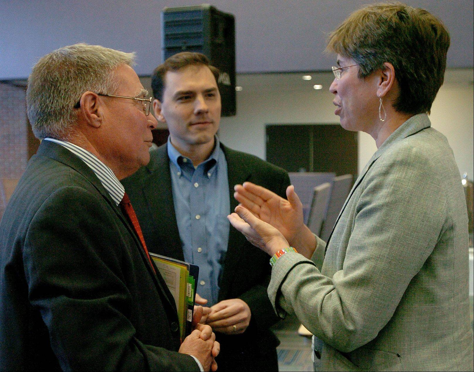 "Lt. Gov. Sheila Simon chats with Harper College President Ken Ender, left, and state Rep. Tom Morrison of Palatine before meeting with students to discuss the statewide initiative ""It Can Wait,"" which urges students to stop texting while driving."