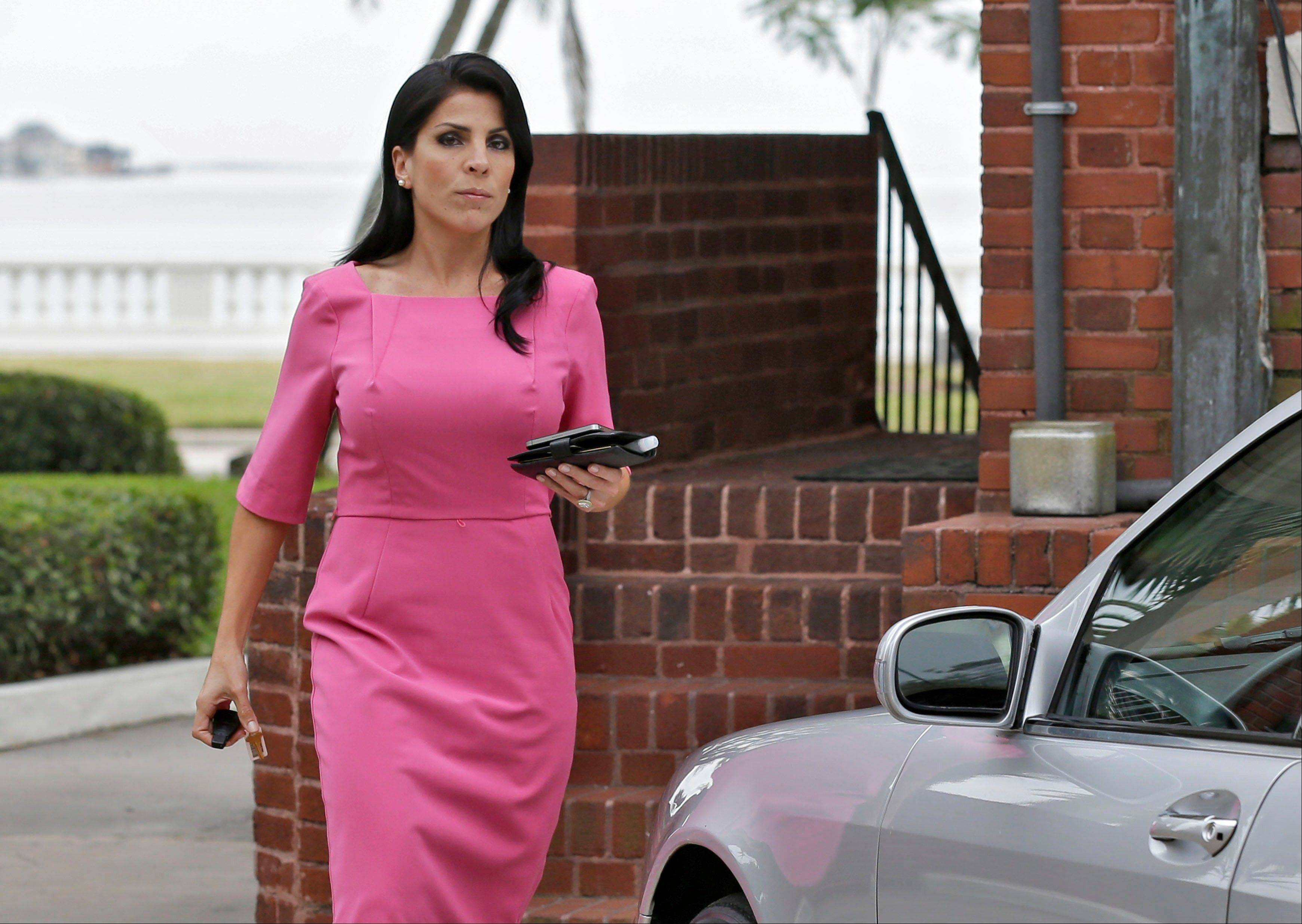 Jill Kelley leaves her home Tuesday, Nov 13, 2012 in Tampa, Fla. Kelley is identified as the woman who allegedly received harassing emails from Gen. David Petraeus' paramour, Paula Broadwell. She serves as an unpaid social liaison to MacDill Air Force Base in Tampa, where the military's Central Command and Special Operations Command are located.