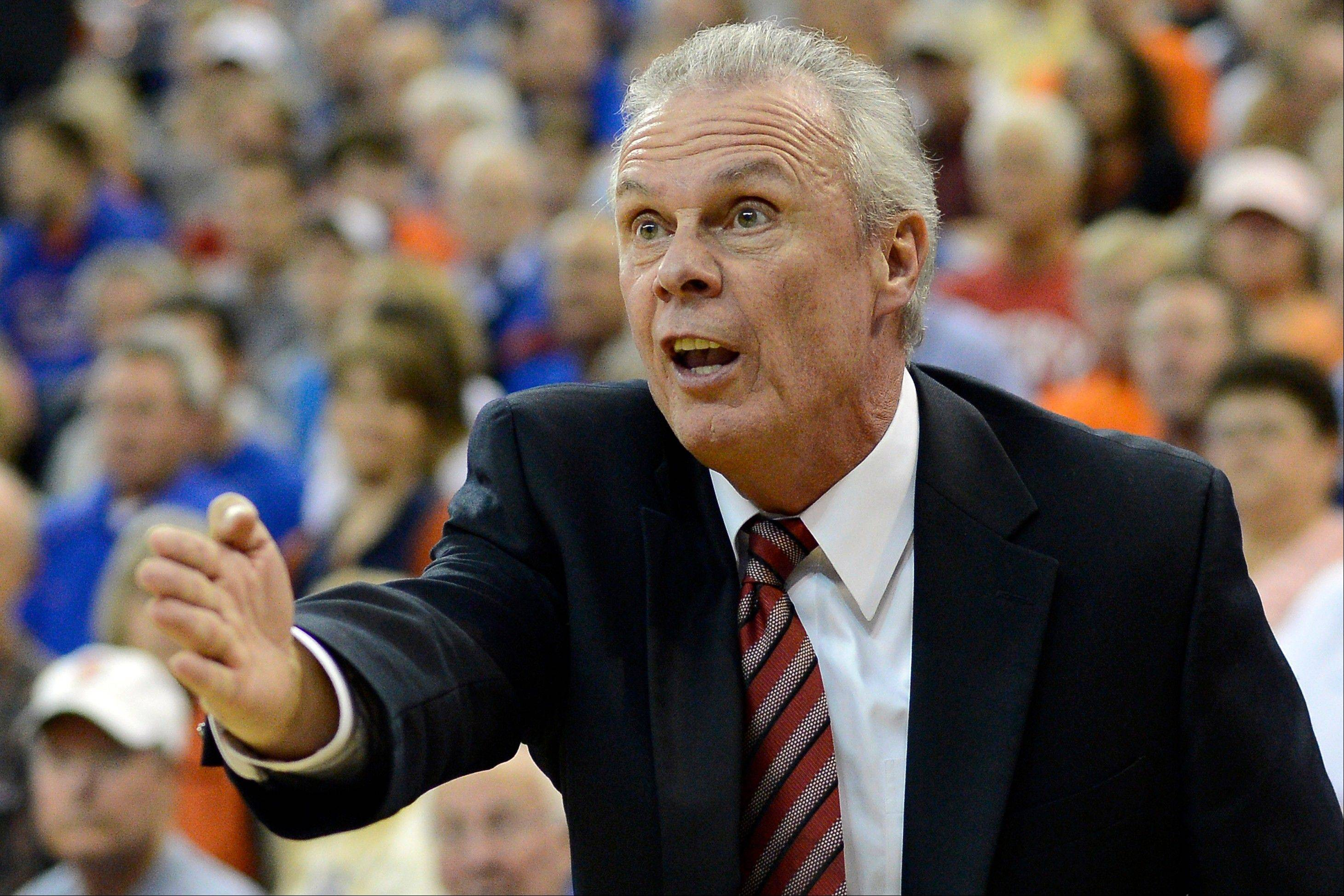 Wisconsin head coach Bo Ryan talks with a referee Wednesday during the first half against Florida in Gainesville, Fla.
