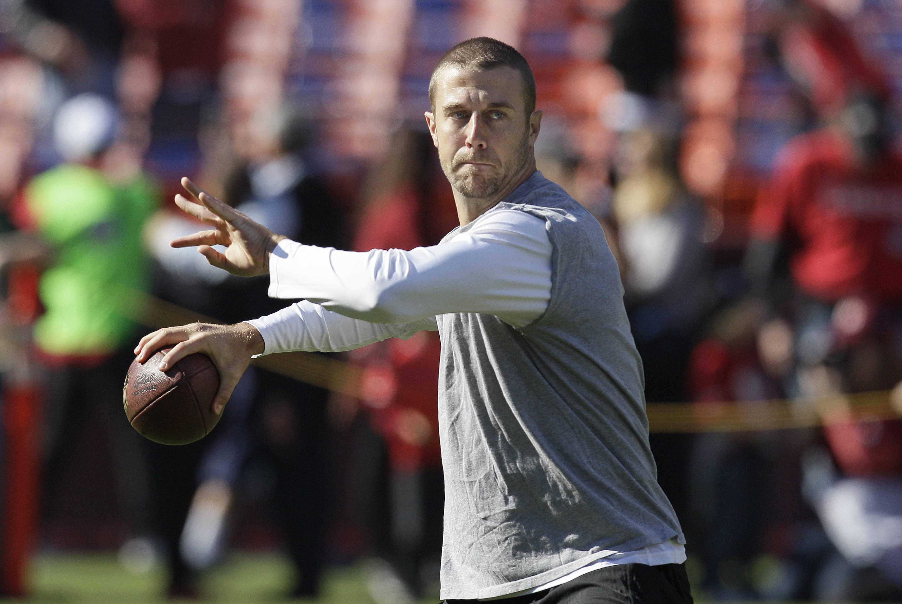 San Francisco 49ers quarterback Alex Smith throws Sunday before playing against the St. Louis Rams in San Francisco. Smith worked out Wednesday, but his status for Sunday's game against the Bears remains uncertain.