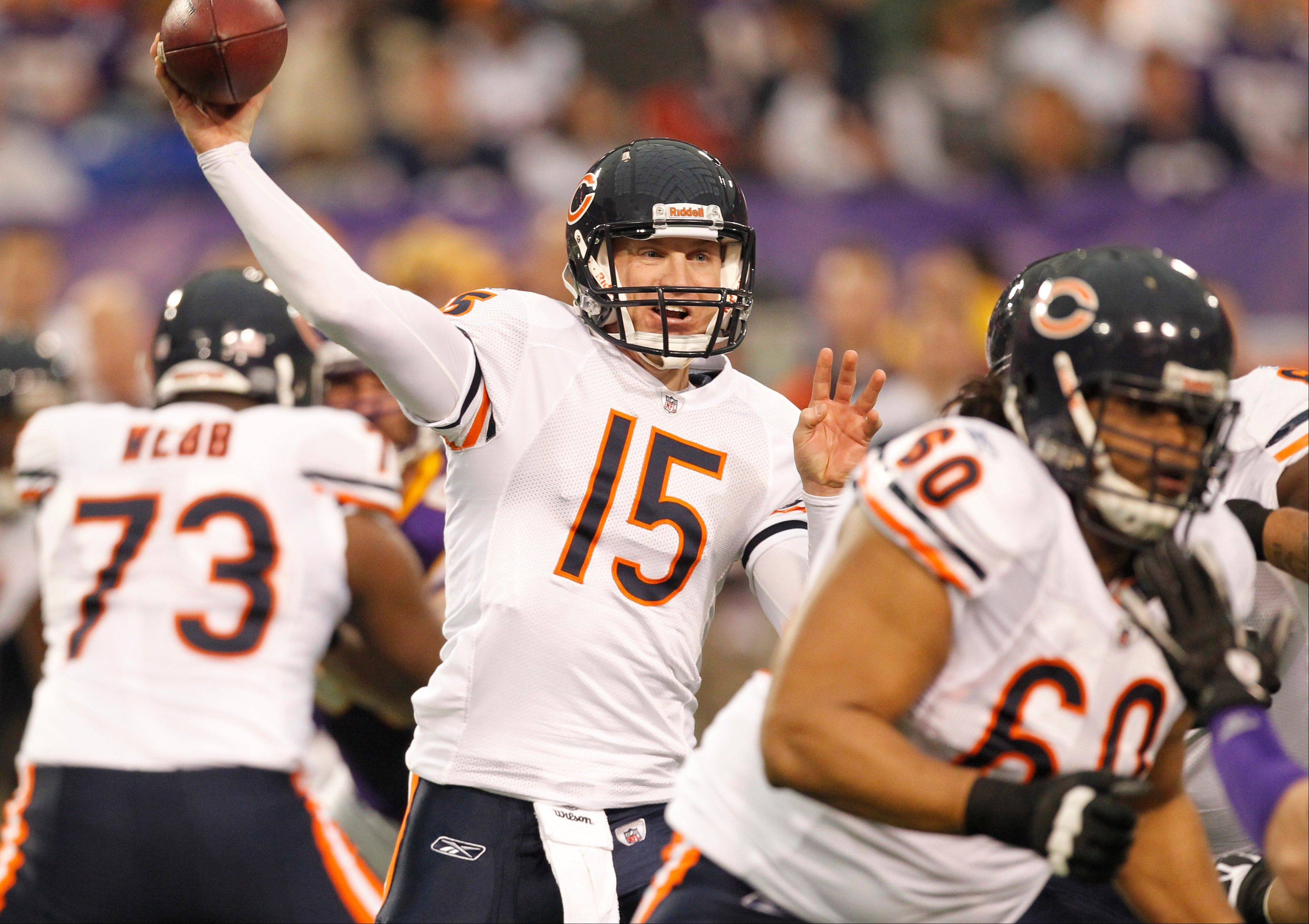 Quarterback Josh McCown, here working against the Minnesota Vikings last January, is back with the Bears after spending the season coaching high school football.