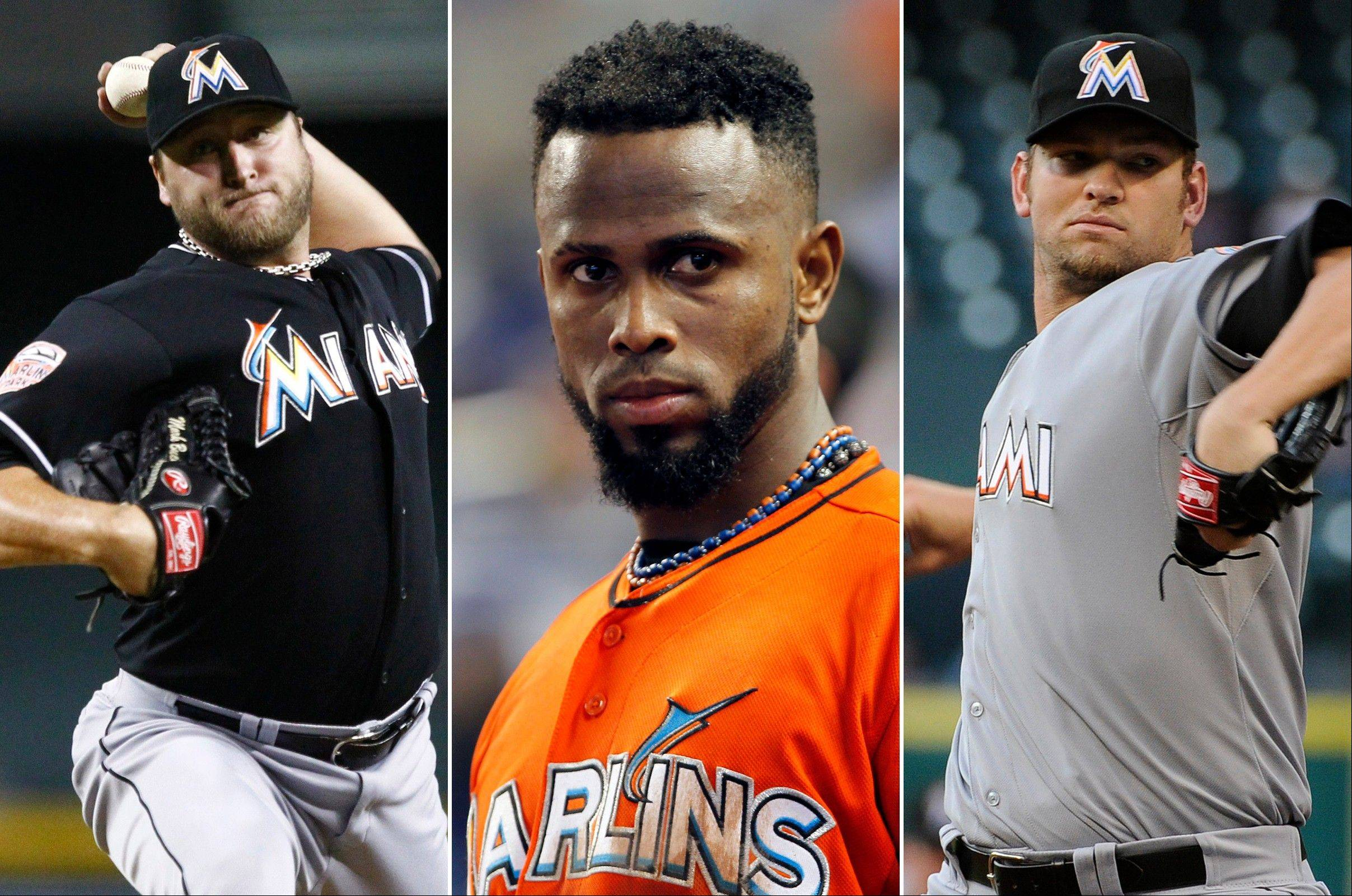 This photo combo made from file photos shows Miami Marlins players, from left, pitcher Mark Buehrle, shortstop Jose Reyes, and pitcher Josh Johnson. Miami traded the three players to the Toronto Blue Jays, a person familiar with the agreement said Tuesday, Nov. 13, 2012. The person confirmed the trade to The Associated Press on condition of anonymity because the teams weren't officially commenting. The person said the trade sent several of the Blue Jays' best young players to Miami.