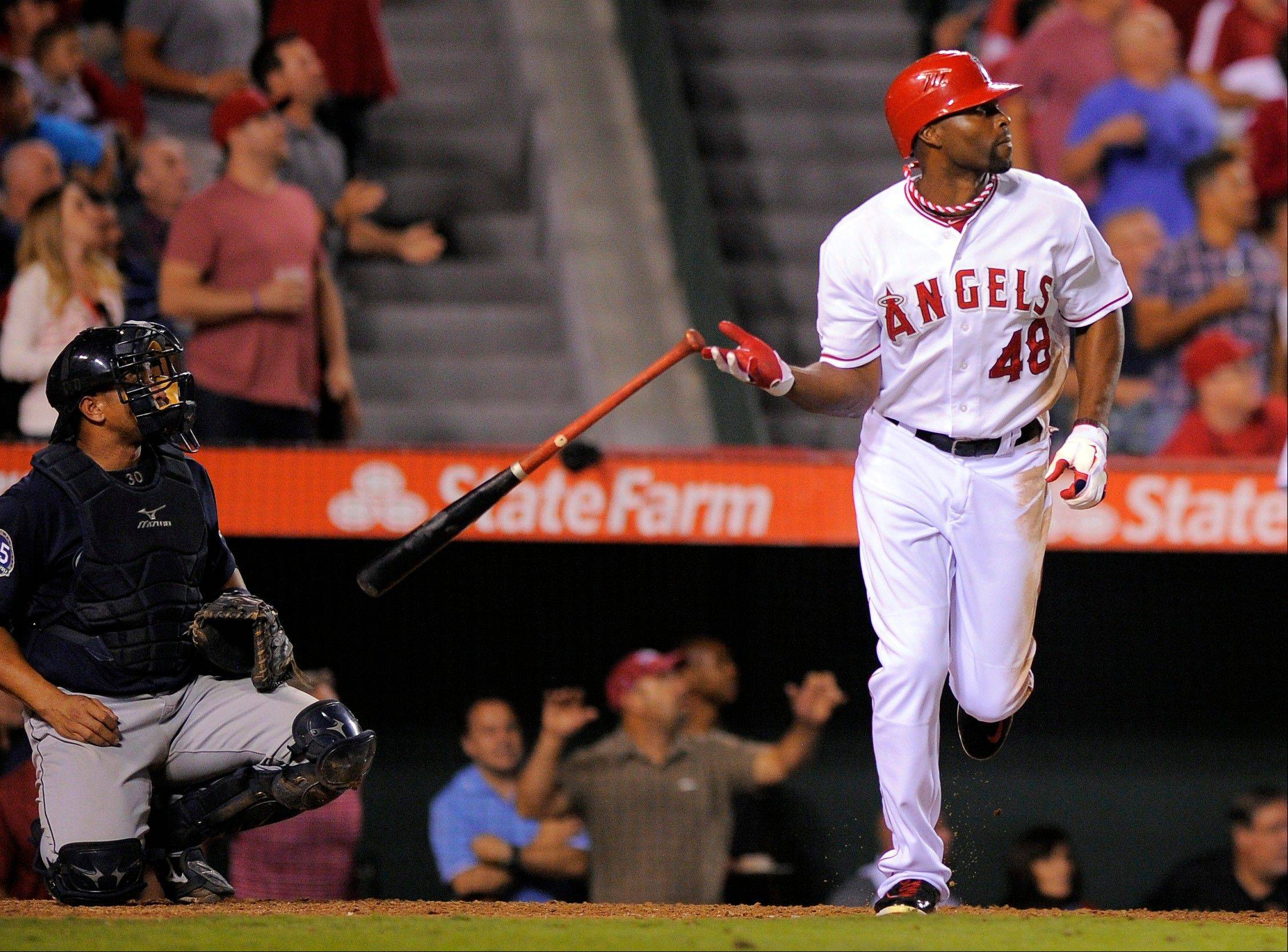 Los Angeles Angels outfielder Torii Hunter, shown dropping his bat after he hit a two-run home run against Seattle, has agreed to a two-year deal with the Detroit Tigers, according to sources.