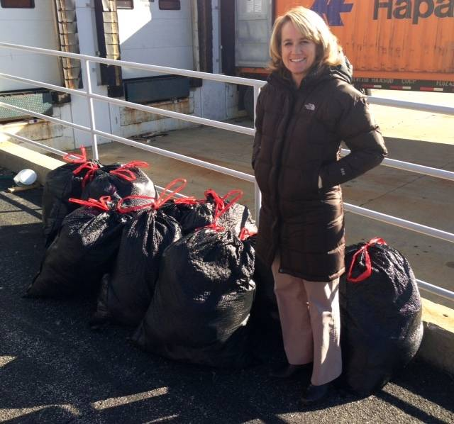 Susan Rogers, NWSC PTA Health & Safety Chair, delivering ten donation bags to RIM Logistics.