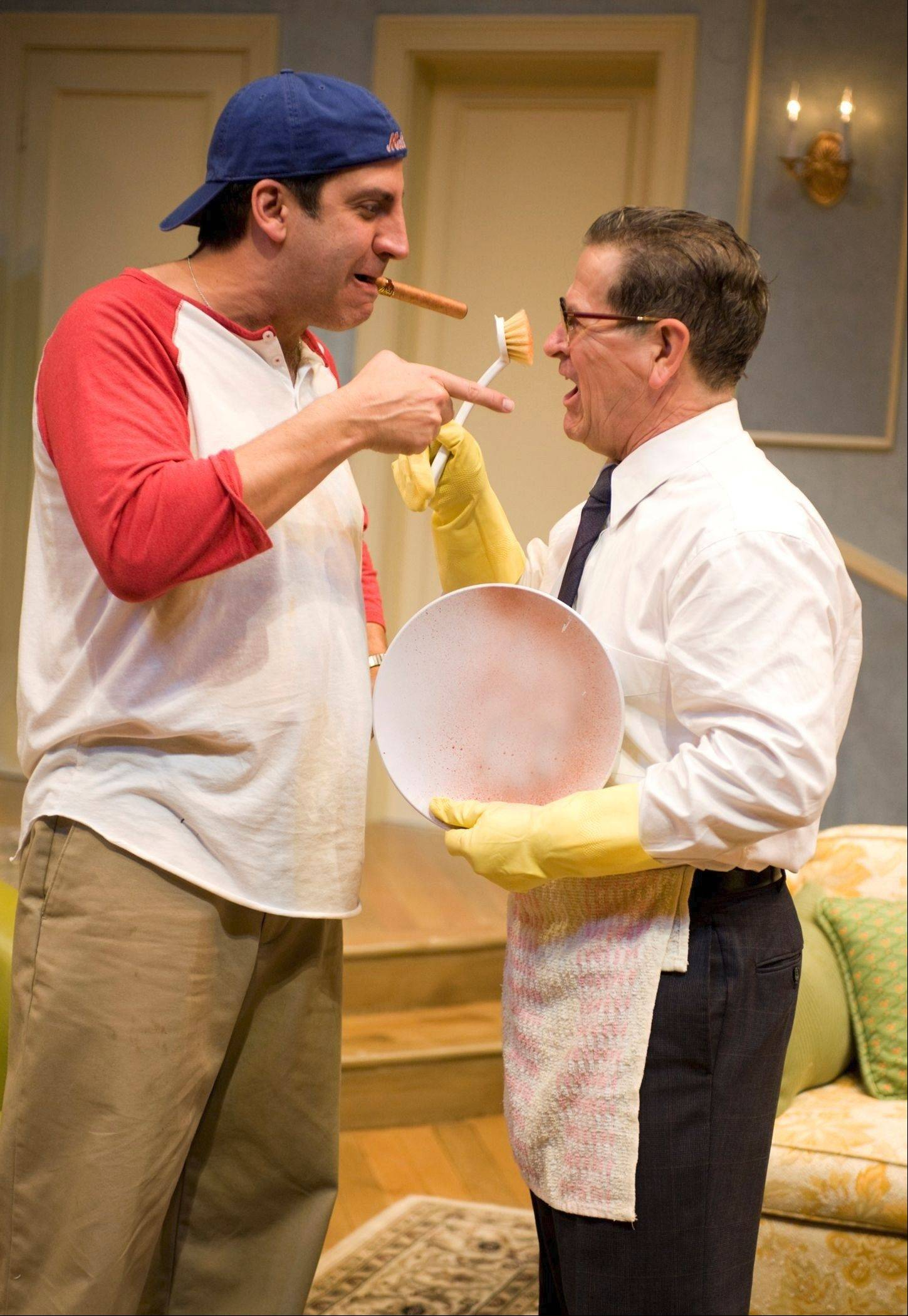 "Poker buddies turned roommates Oscar Madison (Marc Grapey), left, and Felix Unger (Tim Kazurinsky) confront their differences in Northlight Theatre's highly entertaining revival of Neil Simon's ""The Odd Couple."""