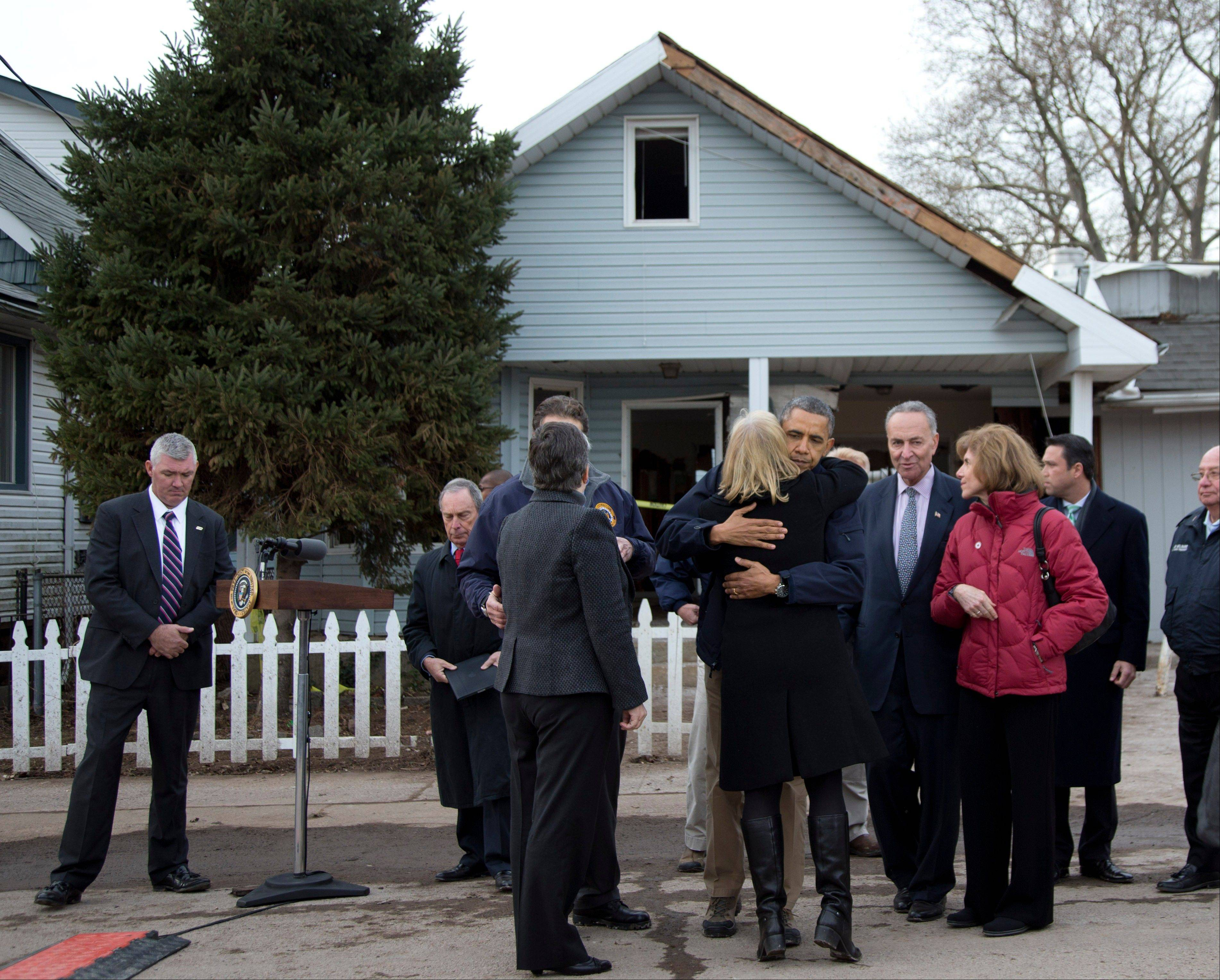 ASSOCIATED PRESS President Barack Obama, accompanied by New York City Mayor Michael Bloomberg, New York Gov. Andrew Cuomo, Homeland Security Secretary Janet Napolitano, Sen. Charles Schumer and others, hugs Sen. Kirsten Gillibrand after a news conference on a street significantly hit by Superstorm Sandy, Thursday on Staten Island in New York.