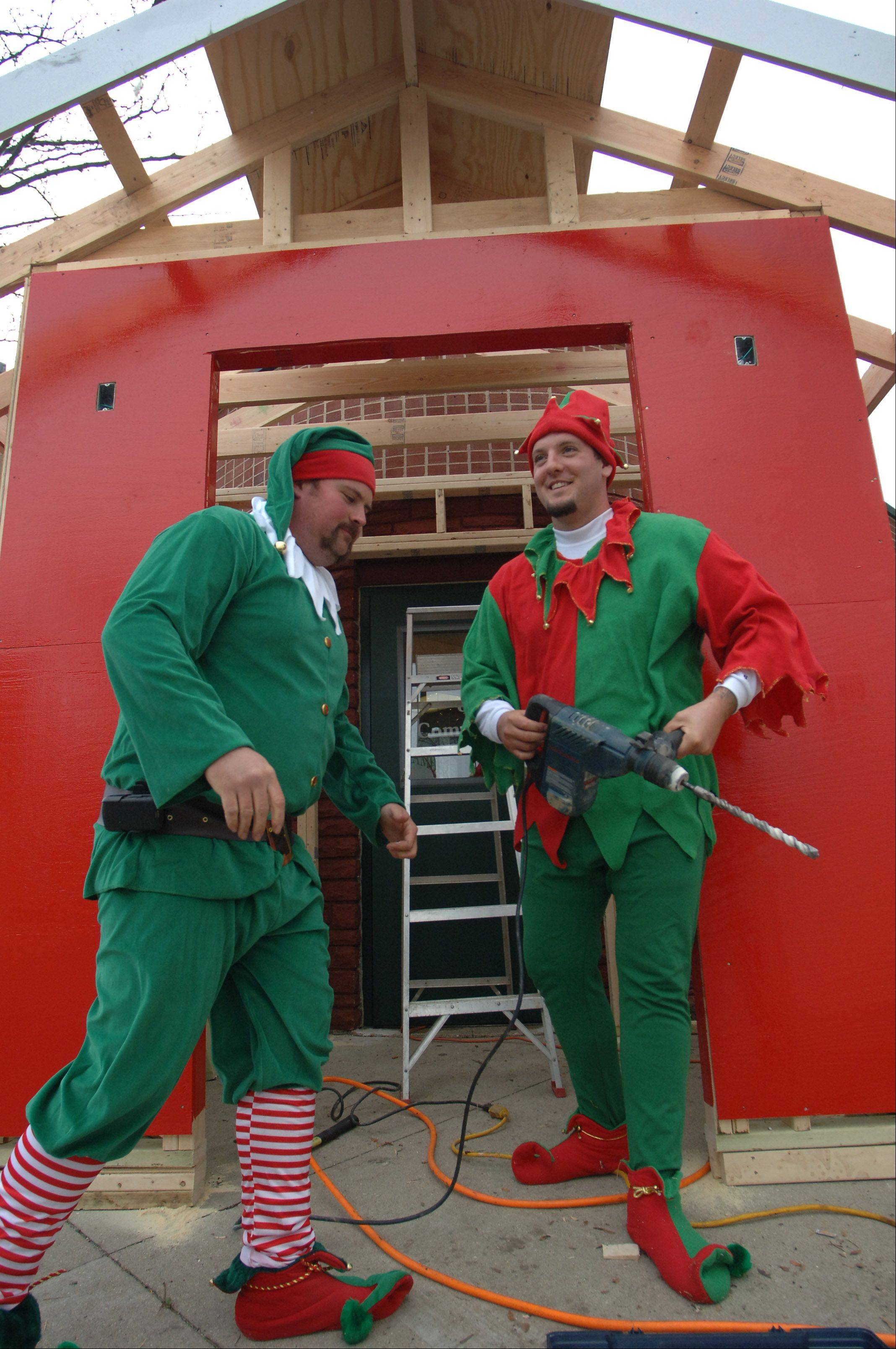 Antioch Public Works employees Tanner Dowell, left, and Scott Dewar are dressed as elves Wednesday while building an entrance to the new Santa�s Enchanted Village. Santa will be visiting with children starting Nov. 23 just inside the chamber of commerce entrance of village hall.