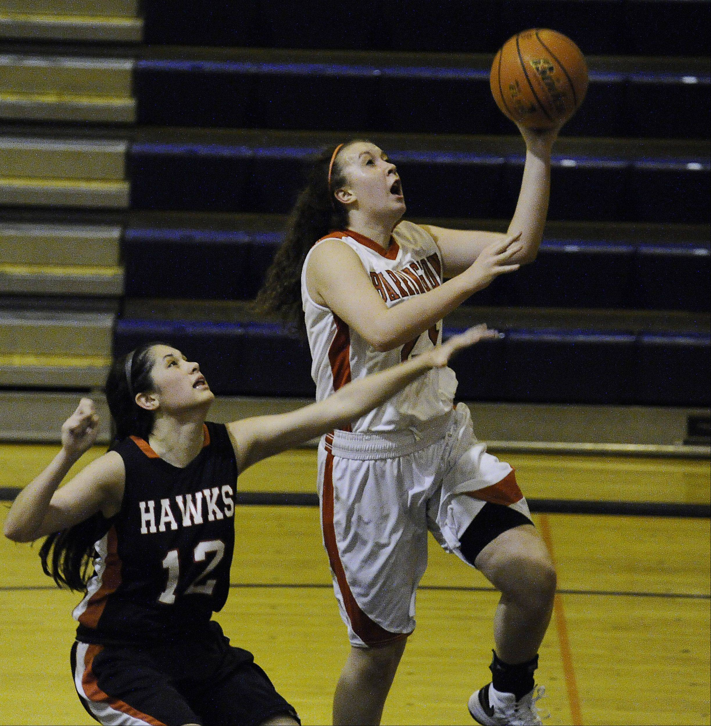Maine South�s Mackenzie Duffy is unable to stop the drive to the basket by Aoife Callanan of Barrington during the Bison Classic girls varsity basketball Thanksgiving Tournament at Buffalo Grove High School on Thursday.