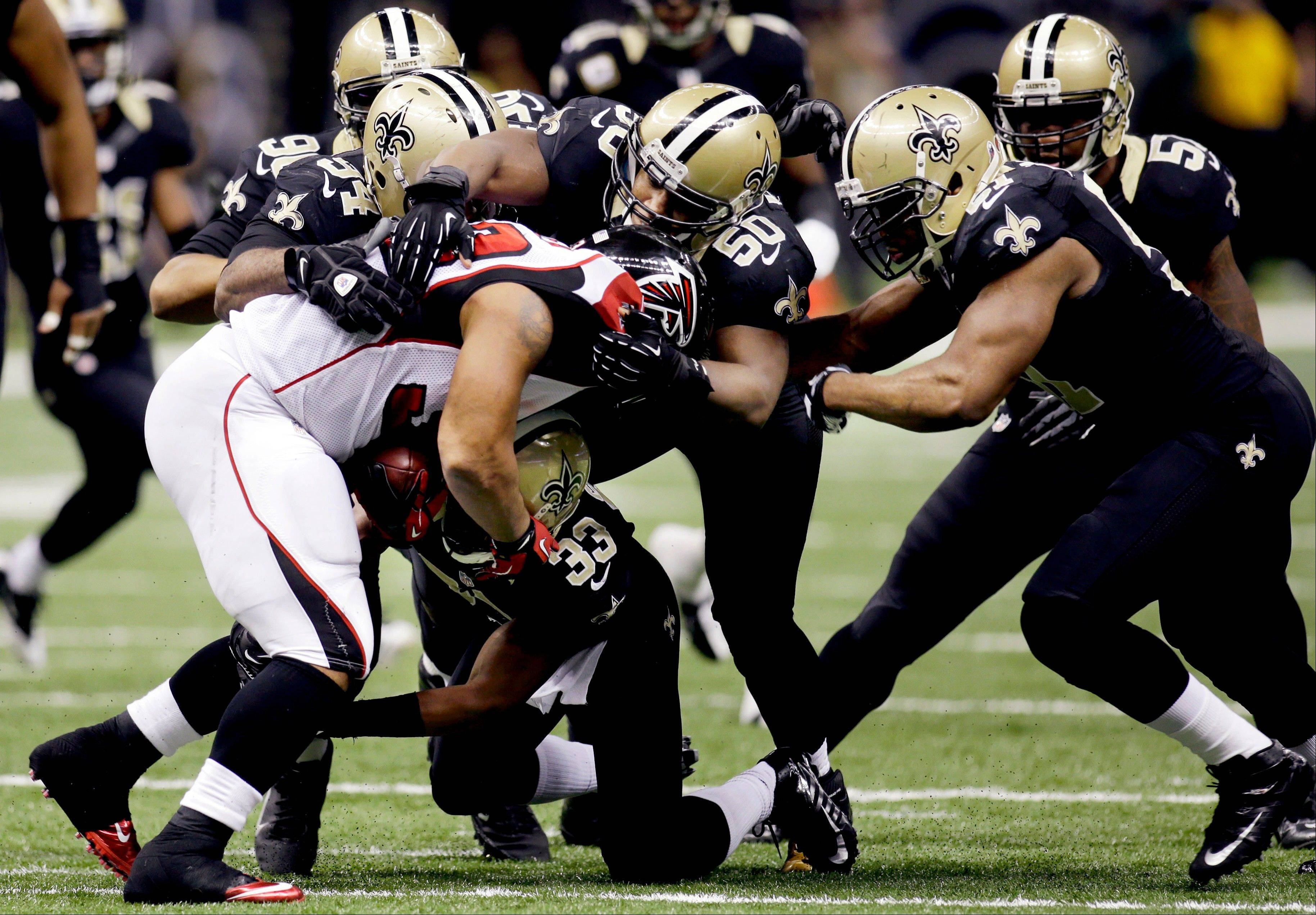 Atlanta Falcons running back Michael Turner is stopped Sunday by New Orleans Saints middle linebacker Curtis Lofton (50), cornerback Jabari Greer (33), defensive end Cameron Jordan (94) and outside linebacker Jonathan Vilma (51) in the second half. Turner says the Atlanta Falcons� rushing attack might not be as bad off as some people think.