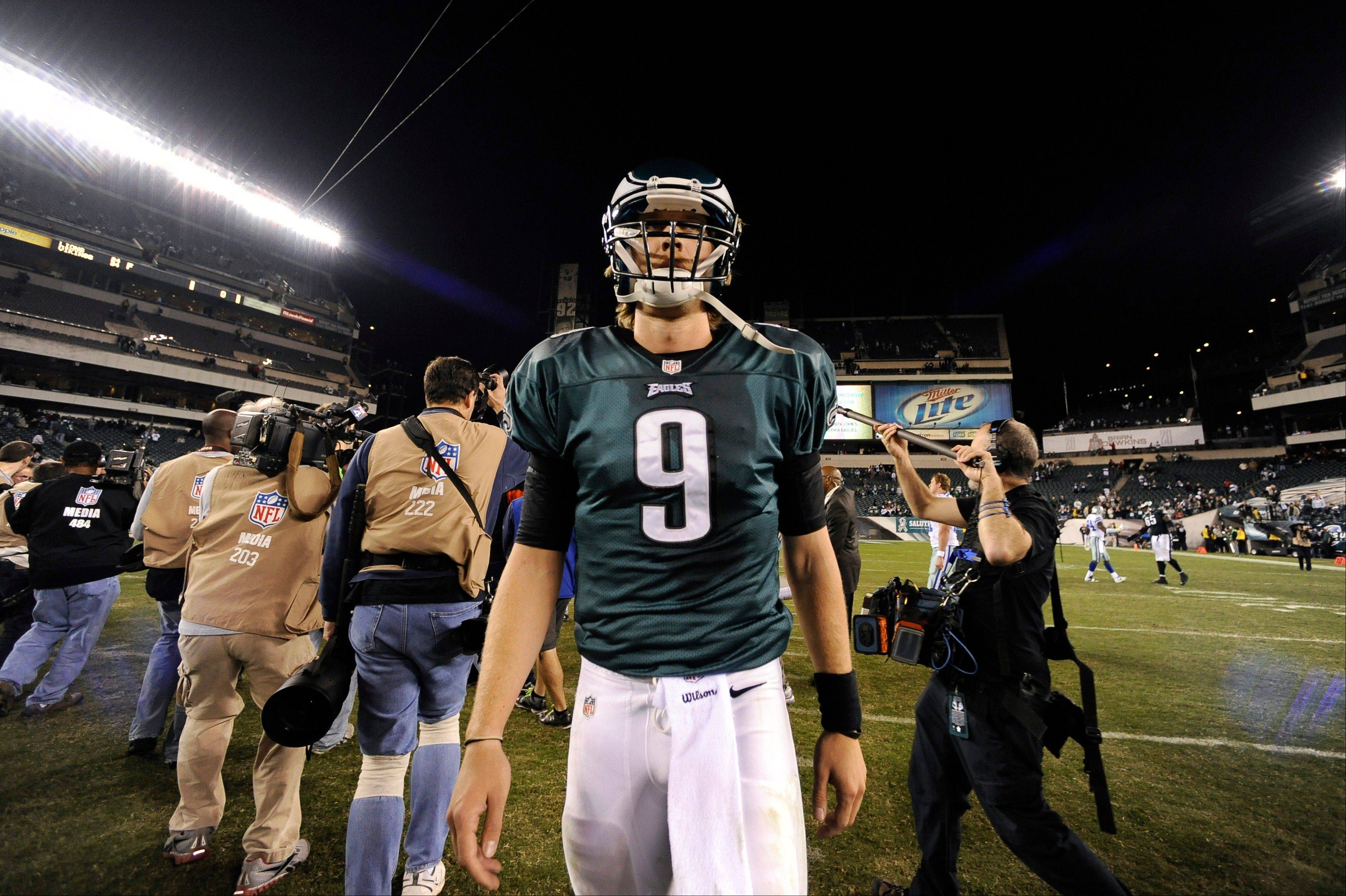 Philadelphia Eagles quarterback Nick Foles walks off the field Sunday after playing against the Dallas Cowboys in Philadelphia. Dallas won 38-23.