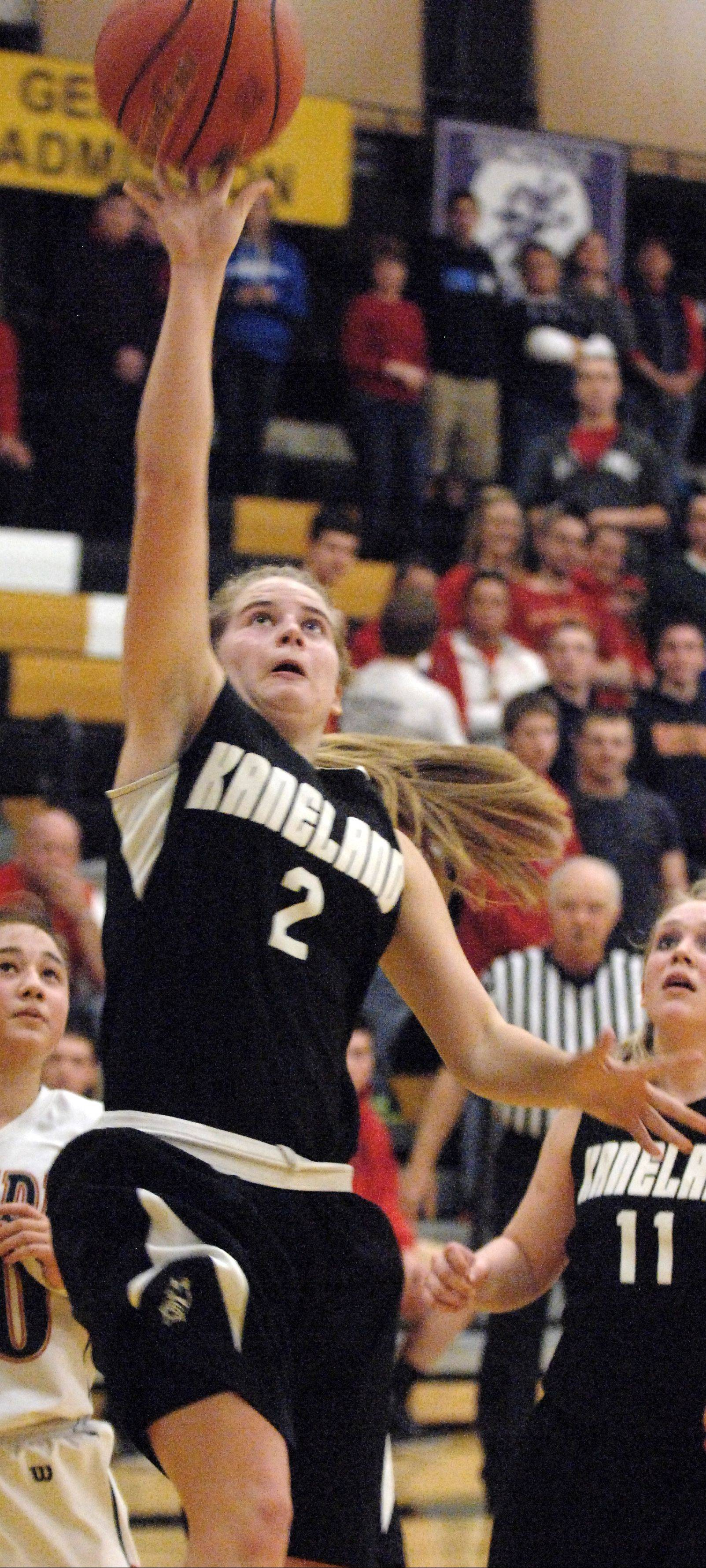 Kaneland�s Sarah Grams, pictured going in for a layup in last year�s sectional championship game against Belvidere North, is one of the seniors who has helped turn the Knights� record around the past few years.