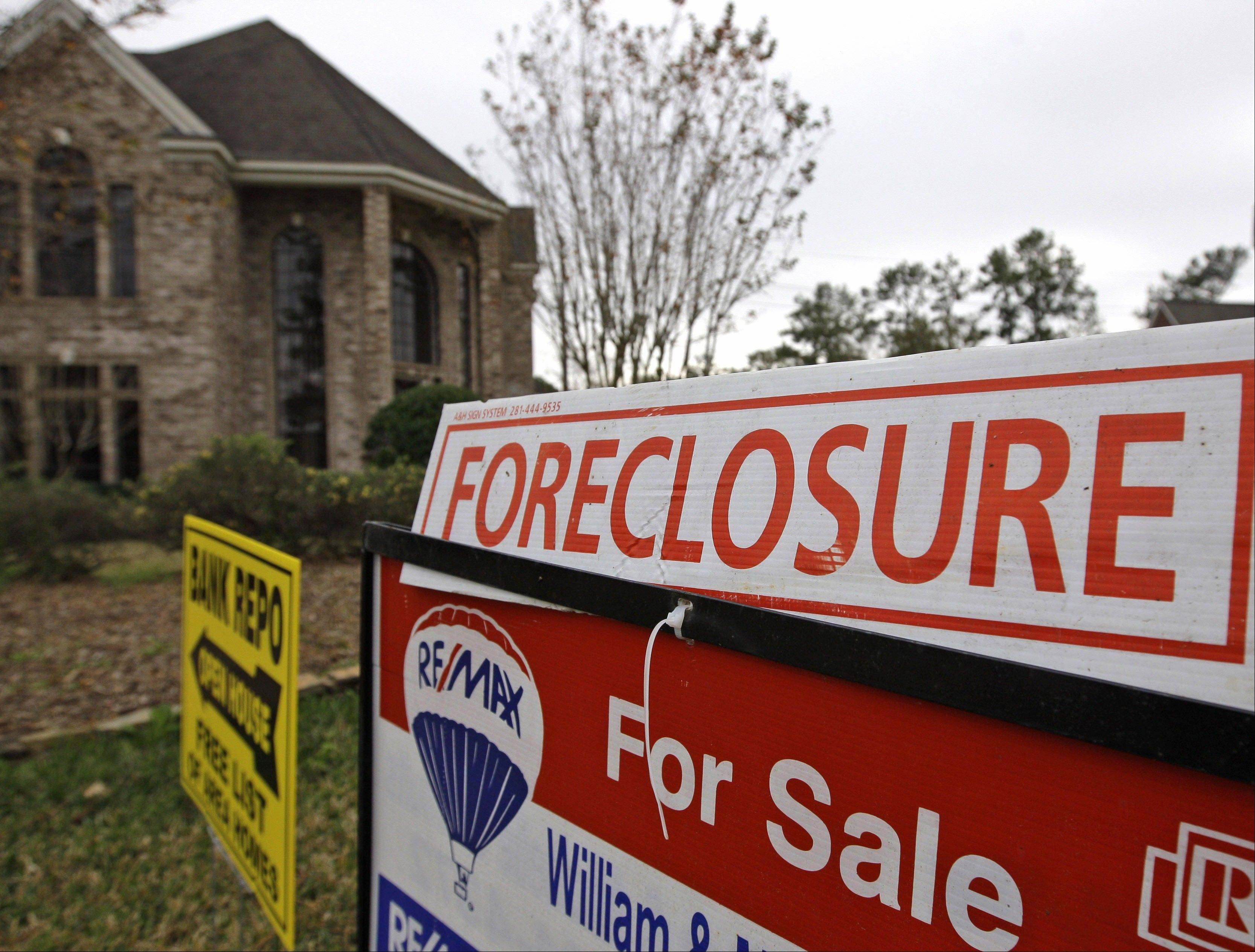 U.S. homes are entering the foreclosure process at a slower pace than a year ago, and fewer properties are being repossessed by lenders, new data show.