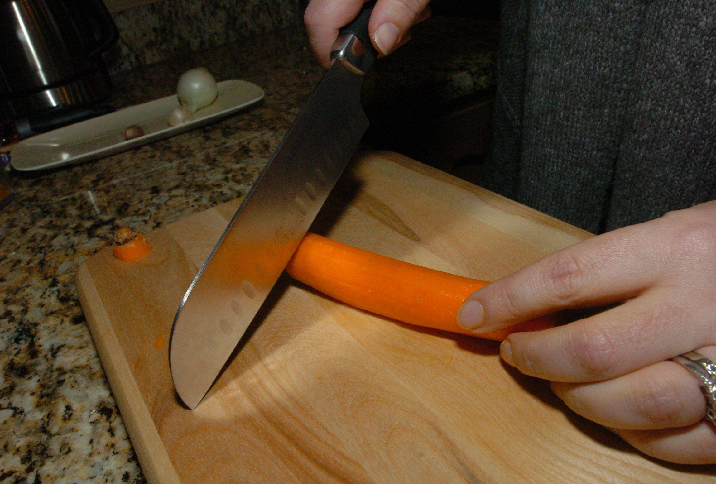 France Cevallos slices carrots for her Creamy Autumn Carrot Soup.