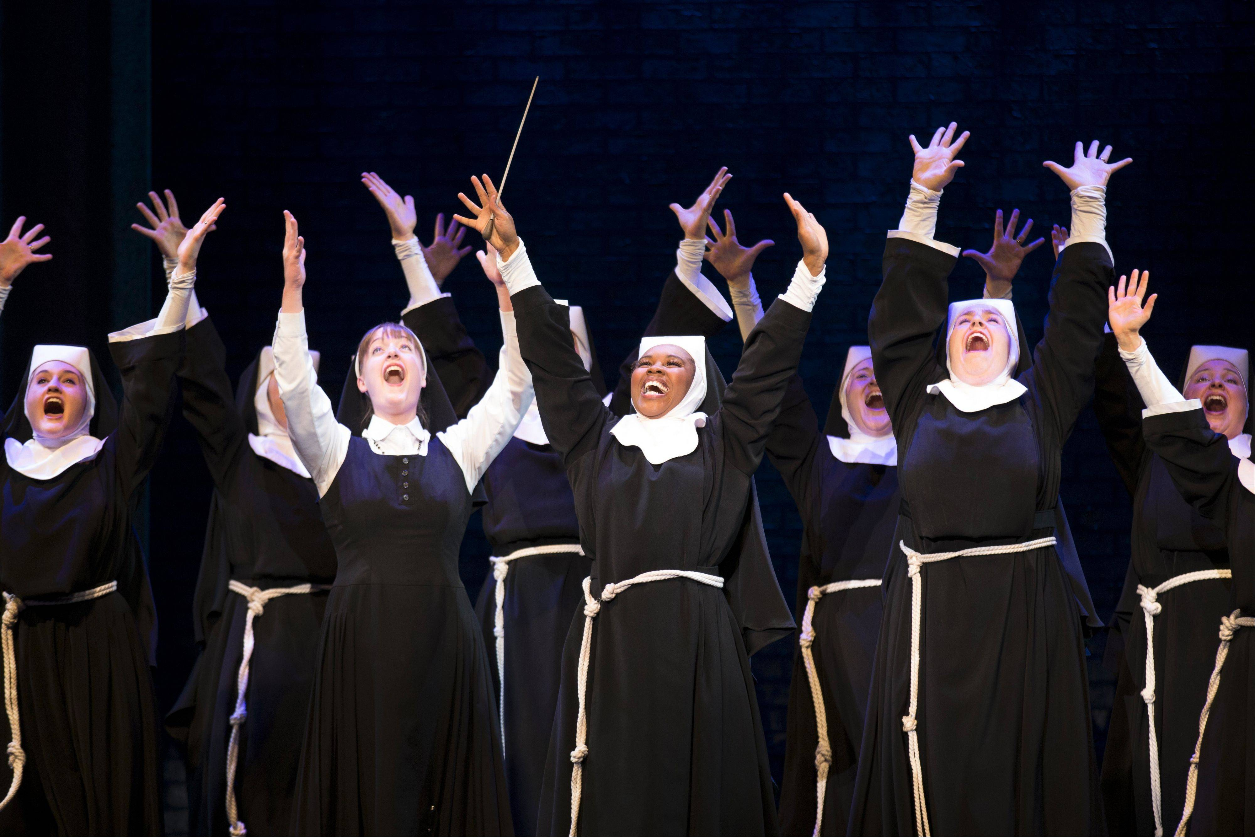 "Disco singer Deloris Van Cartier (Ta'Rea Campbell, center) works her musical magic on a group of nuns in the national tour of the 2011 Broadway musical ""Sister Act."" The show continues at the Auditorium Theatre of Roosevelt University in Chicago through Sunday, Dec. 2."