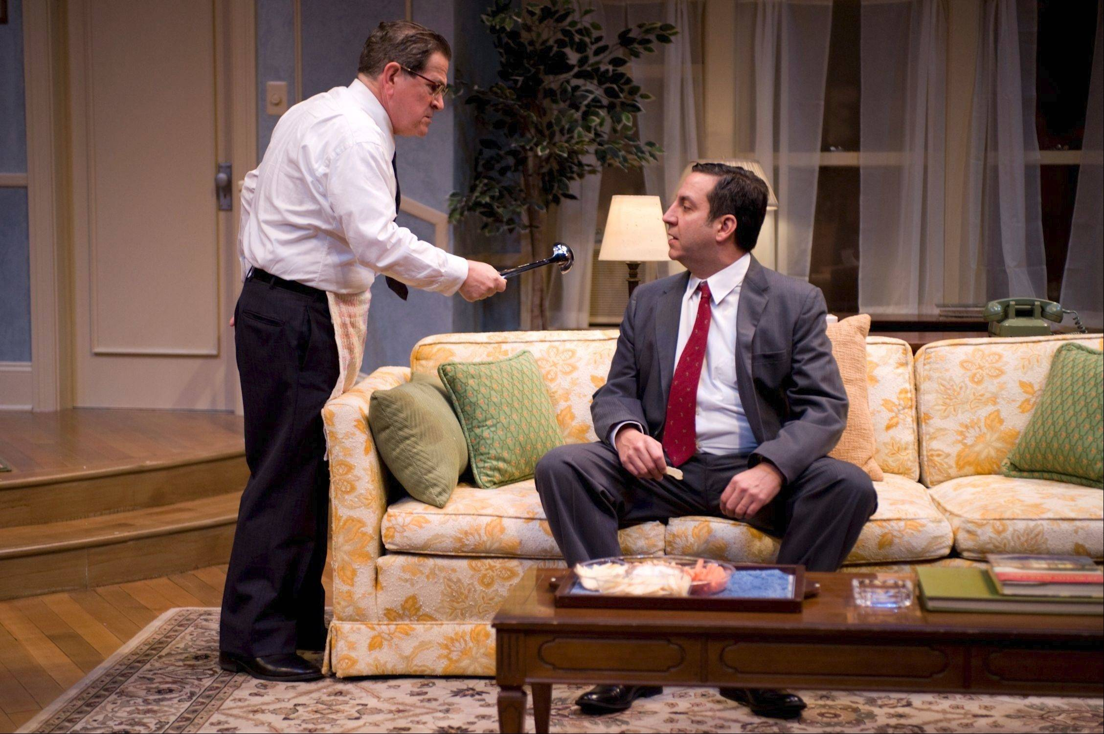 "Tensions between mismatched roommates Felix Ungar (Tim Kazurinsky), left, and Oscar Madison (Marc Grapey) come to a boil in BJ Jones' production of ""The Odd Couple"" running through Dec. 16 at Northlight Theatre."