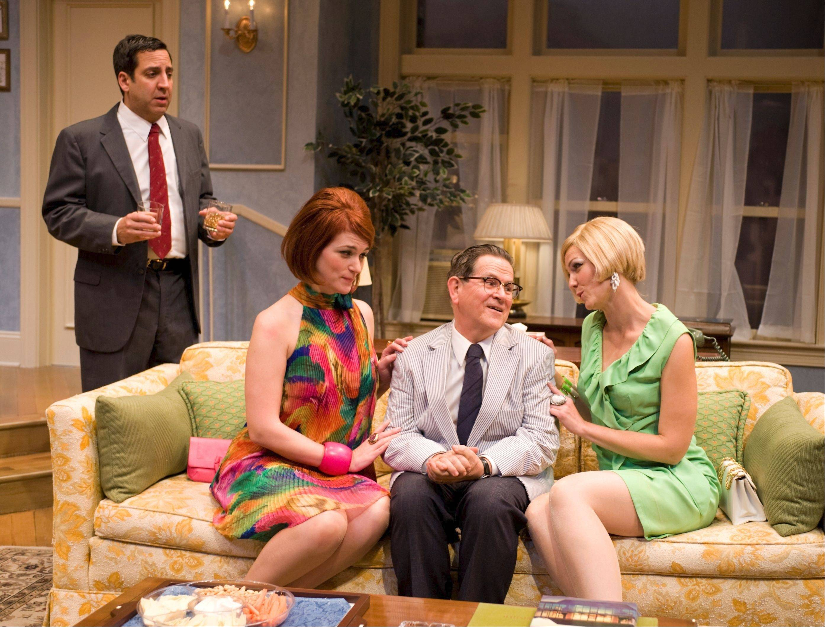 "The Pigeon Sisters, Gwendolyn (Katherine Keberlein), second from left, and Cecily (Molly Glynn) comfort a distraught Felix (Tim Kazurinsky), second from right, to the chagrin of Oscar (Marc Grapey) during a dysfunctional dinner party in Northlight Theatre's revival of Neil Simon's 1965 comedy ""The Odd Couple."""