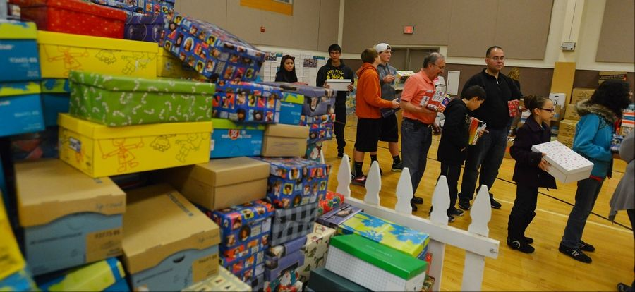 Volunteers gather Saturday morning in Gurnee to pack 4,000 shoe boxes with toys and school supplies that will be delivered to needy children overseas as part of Operation Christmas Child.
