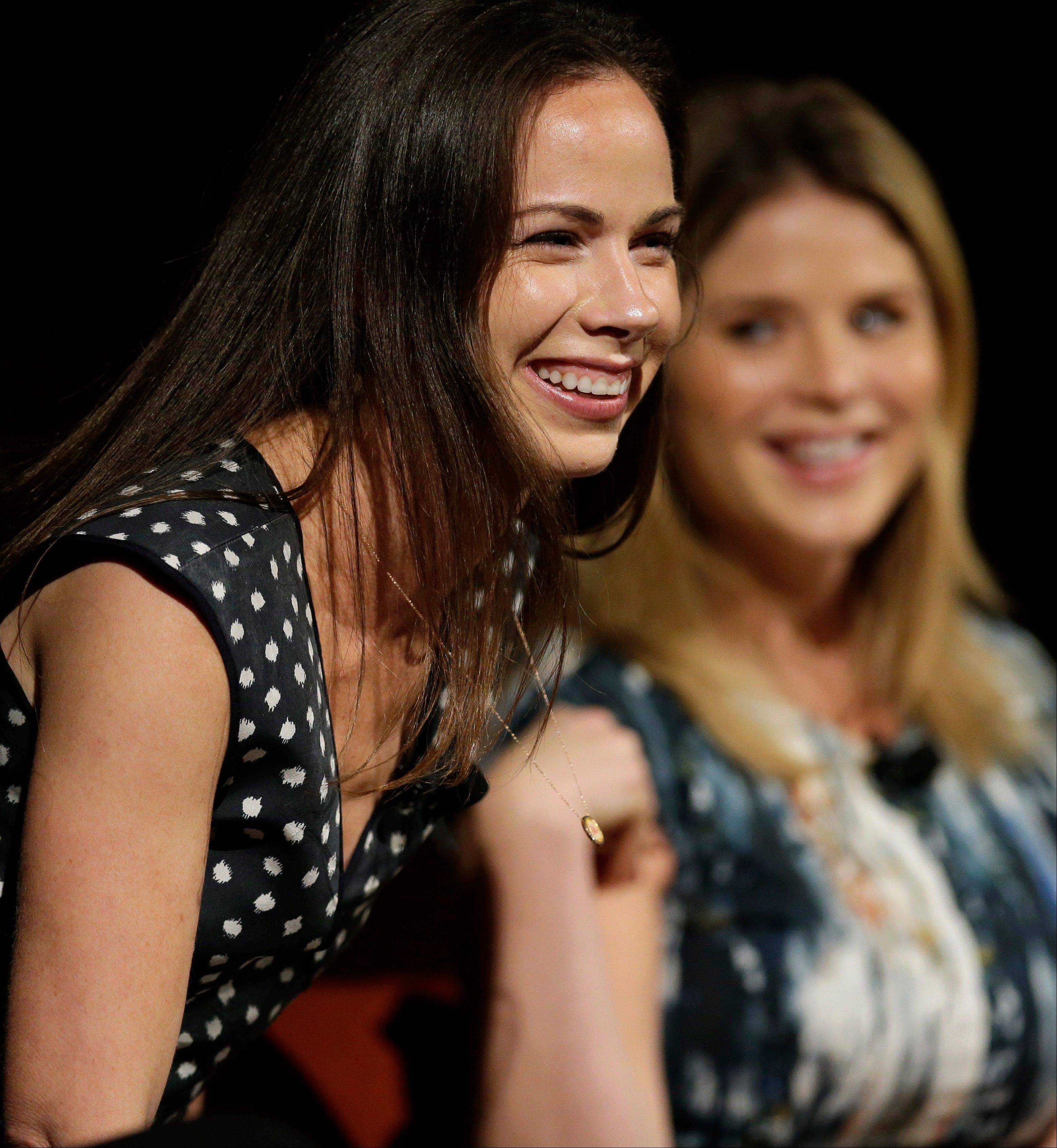 Barbara Pierce Bush, left, laughs with her sister Jenna Bush Hager, right, as they take part in the Enduring Legacies of America�s First Ladies conference Thursday in Austin, Texas. The children of three presidents discussed life in the White House as part of a conference on first ladies at the Lyndon B. Johnson Presidential Library.