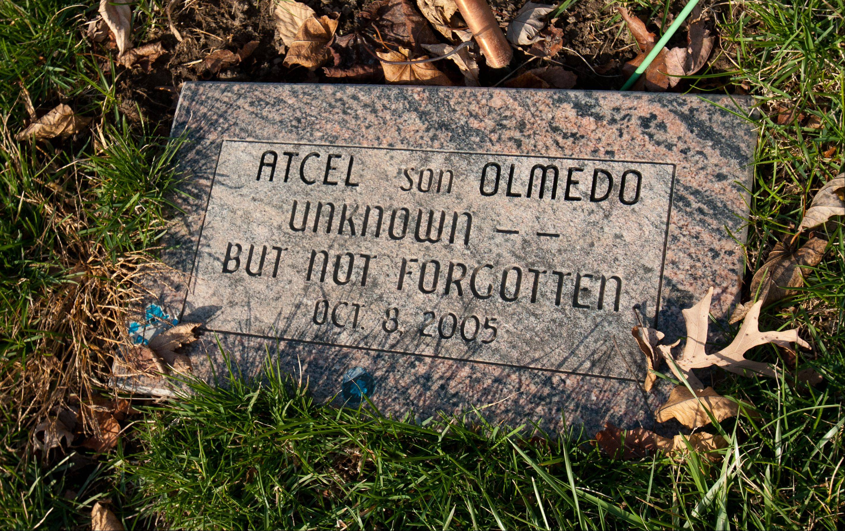 A previously nameless boy found dead seven years ago in Naperville Township has been identified as Atcel Olmedo. The boy was buried in Wheaton's Assumption Cemetery.