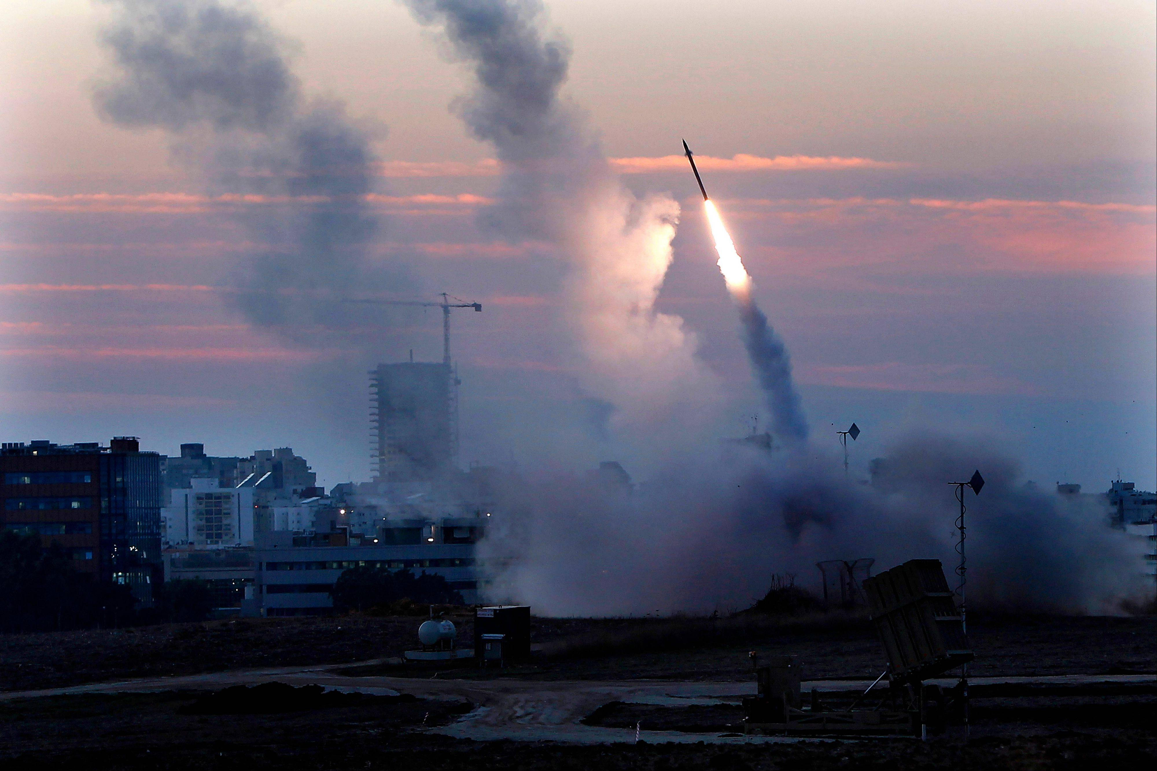 "The Iron Dome defense system fires to interecpt incoming missiles from Gaza in the port town of Ashdod on Thursday. Israelís prime minister Benjamin Netanyahu said Thursday that the army is prepared for a ""significant widening"" of its operation in the Gaza Strip."
