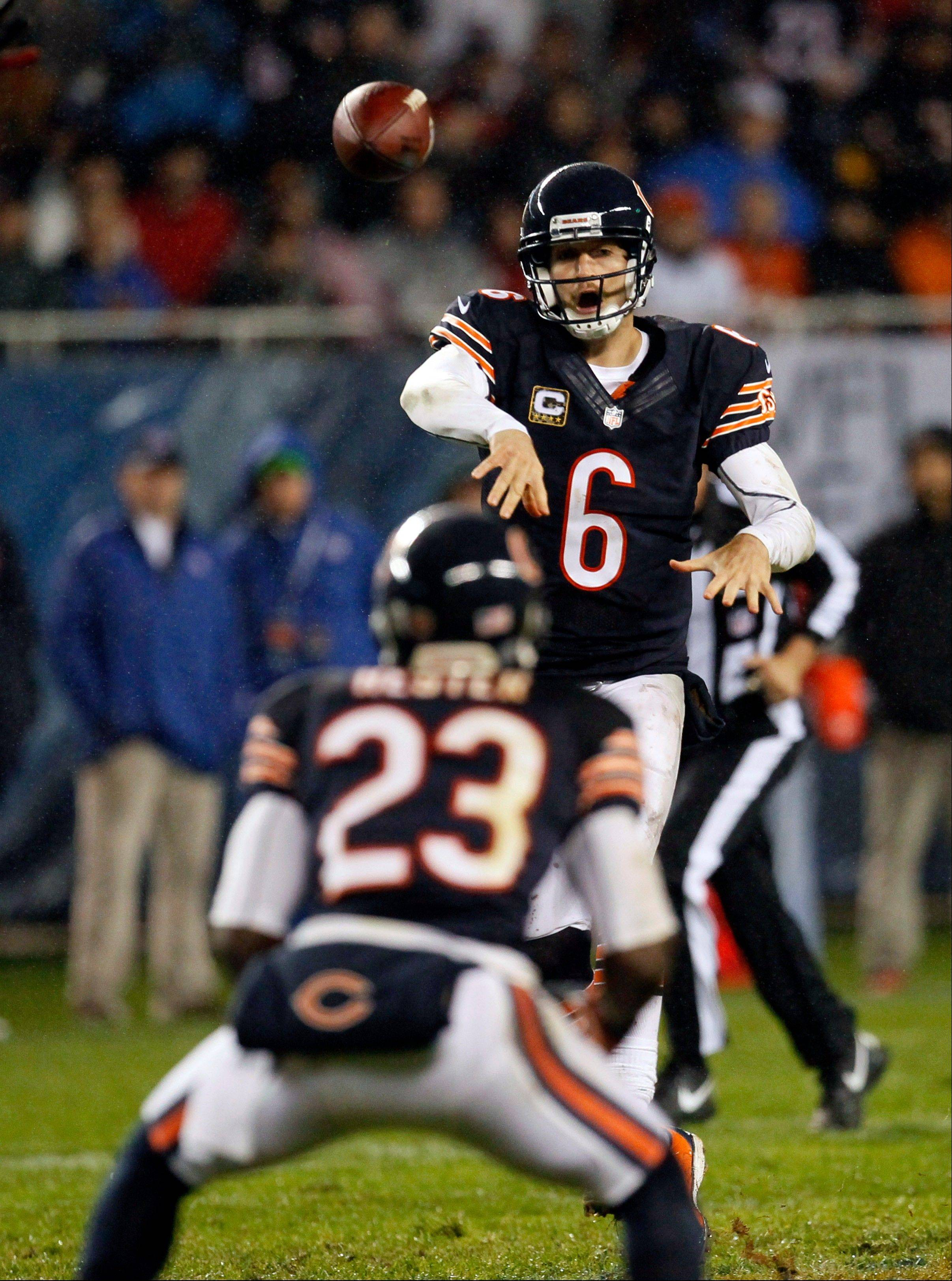 Jay Cutler throws an illegal forward pass to Devin Hester in the first half of the Bears' loss to Houston.