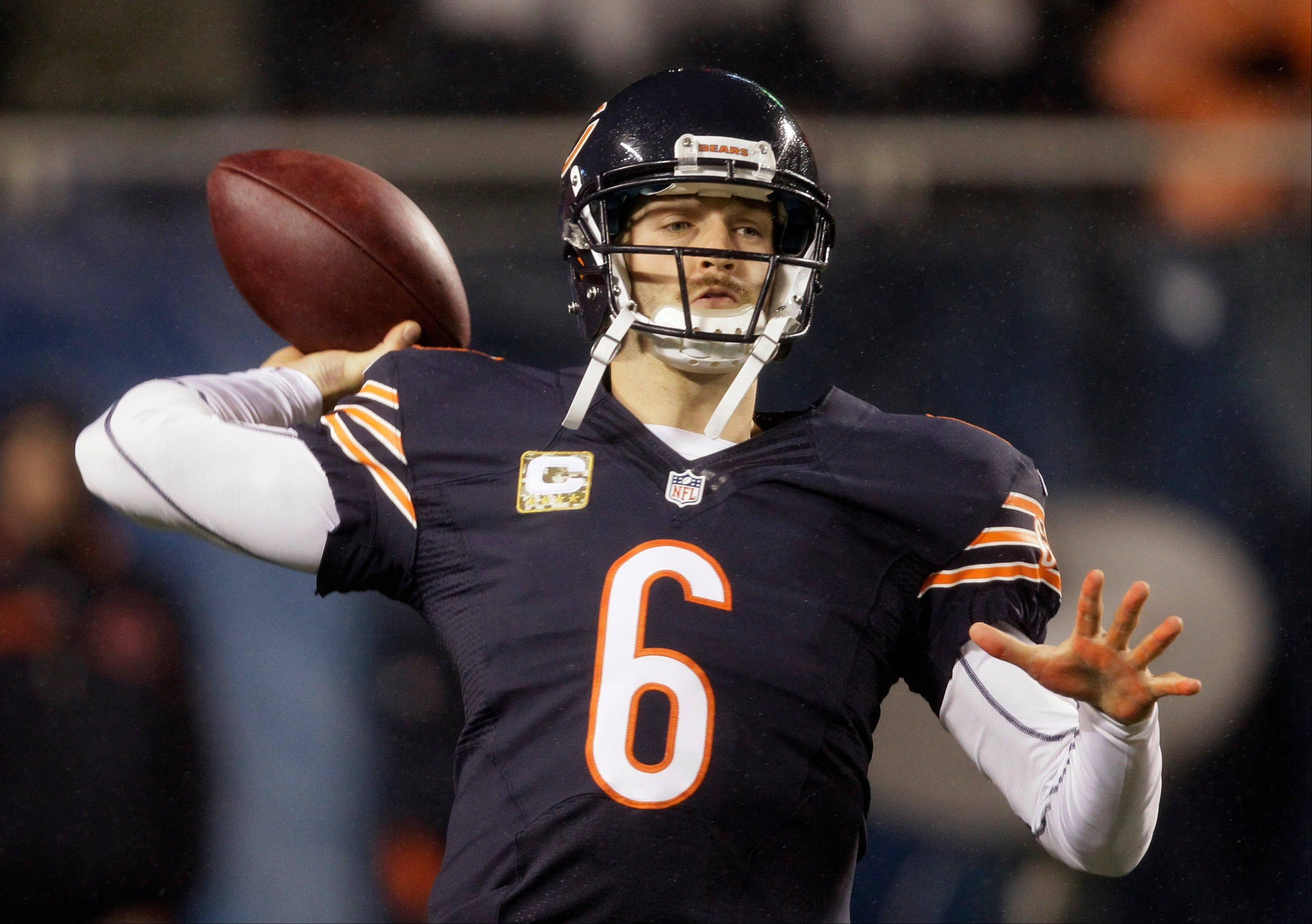Bears quarterback Jay Cutler warms up Sunday.