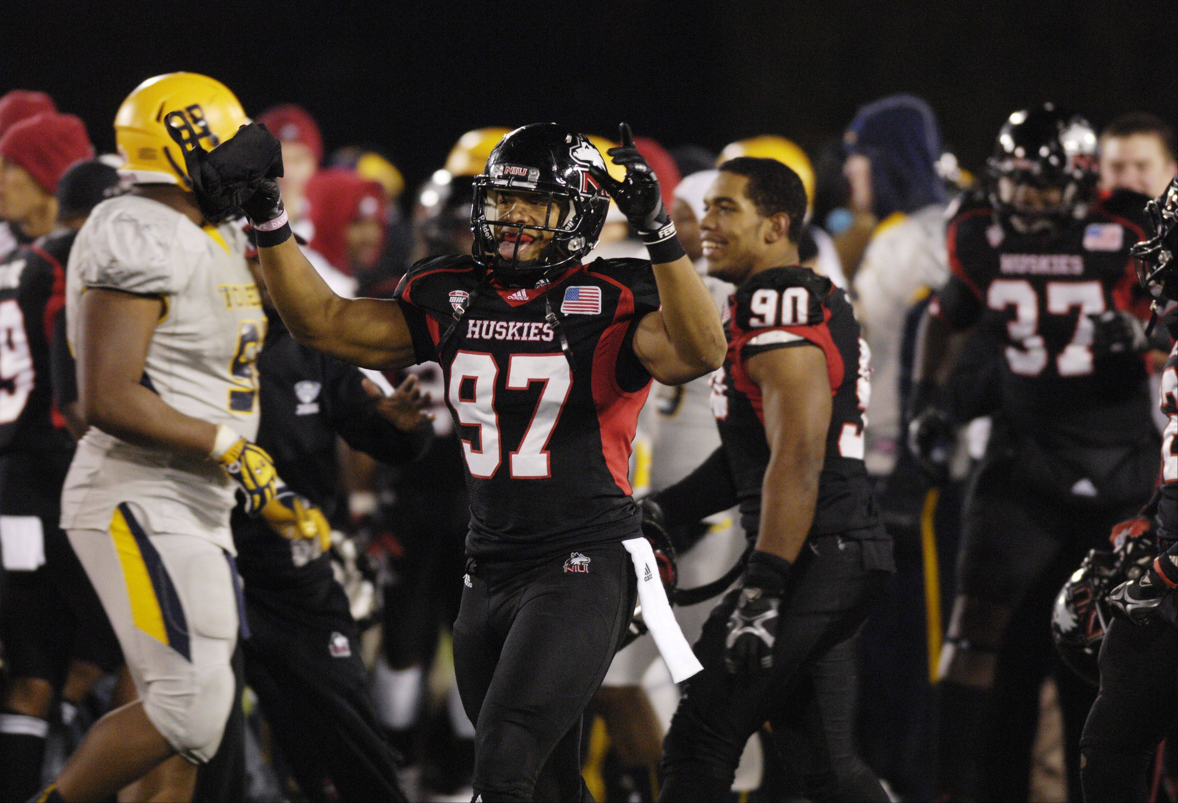 Joe Windsor of Northern Illinois University celebrates with his Huskies teammates after collecting their 10th win of the season, a 31-24 victory of the Toledo Rockets in DeKalb on Wednesday.