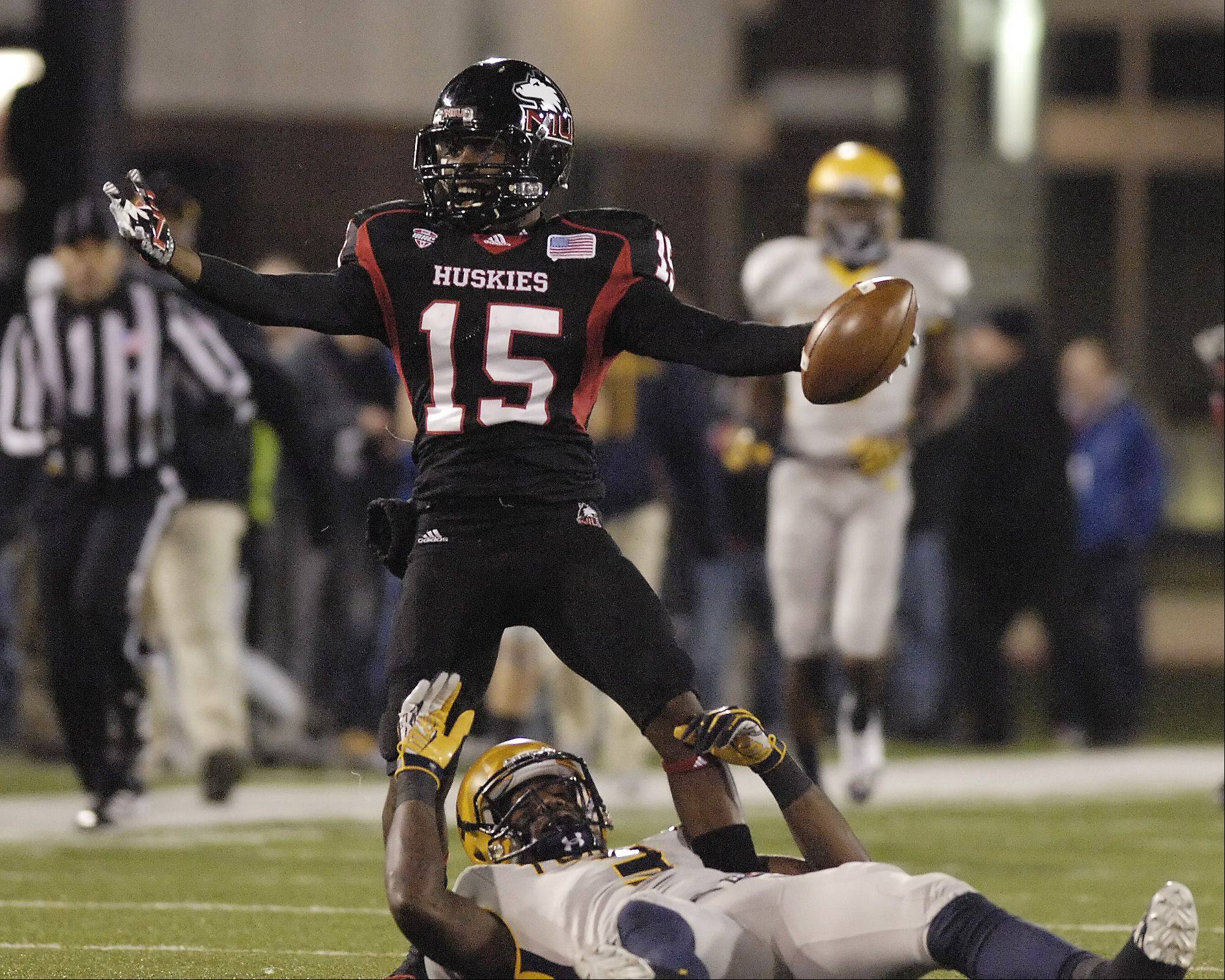 Mark Black/mblack@dailyherald.com Jimmie Ward of Northern Illinois University celebrates a second quarter interception against the Toledo Rockets in Dekalb, Wednesday.