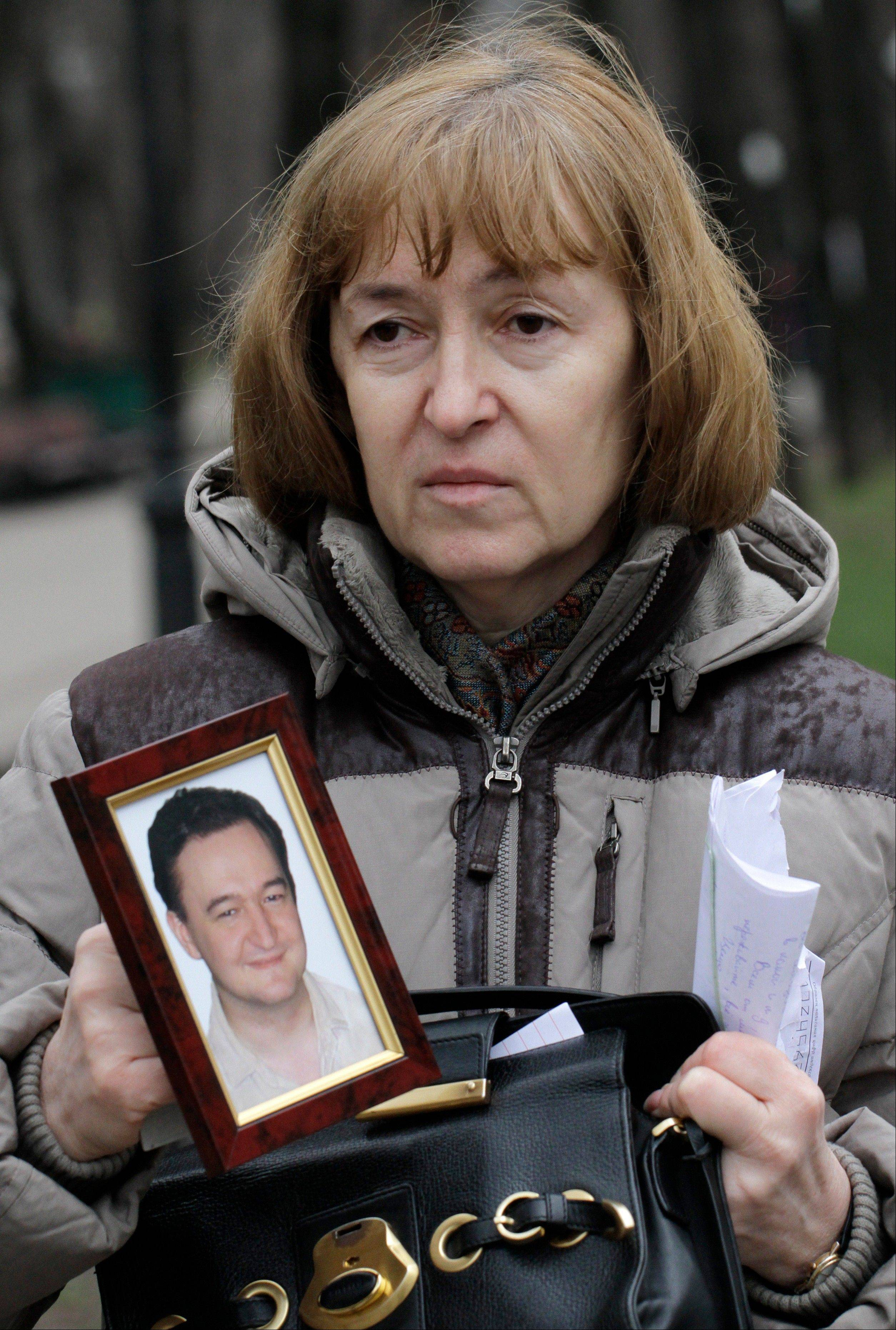 Nataliya Magnitskaya, mother of lawyer Sergei Magnitsky who died in jail, holds a photo of her son. While U.S. lawmakers are voting to open up trade with the country, human rights remain a sticking point in relations.