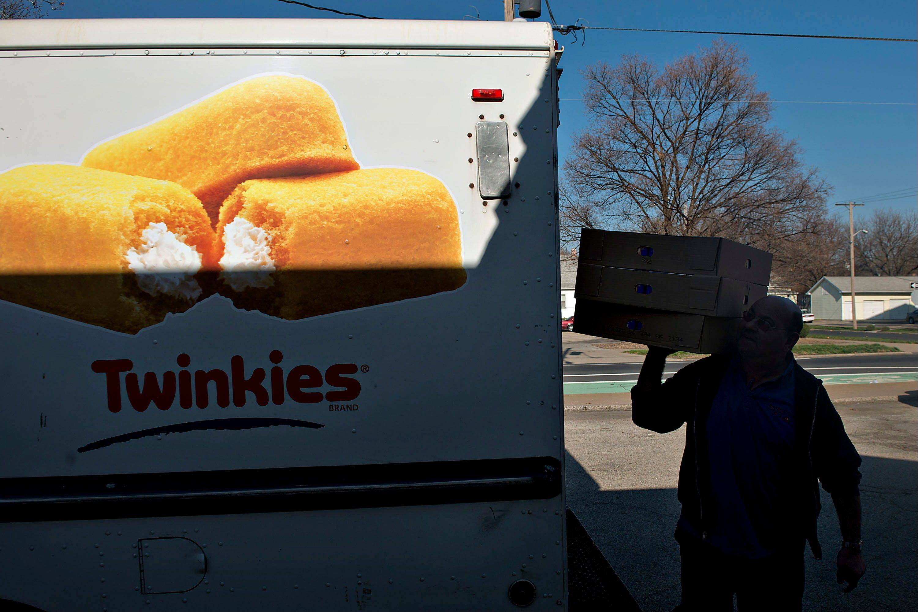 Gary Keller, a Hostess driver for 16-years, carries the last items of his final delivery Friday at a Hostess Brands Inc. Bakery Outlet store in Peoria. Hostess Brands Inc., the bankrupt maker of Wonder bread and Twinkies, said it will fire more than 18,000 workers and liquidate after a nationwide strike by bakery workers crippled operations.