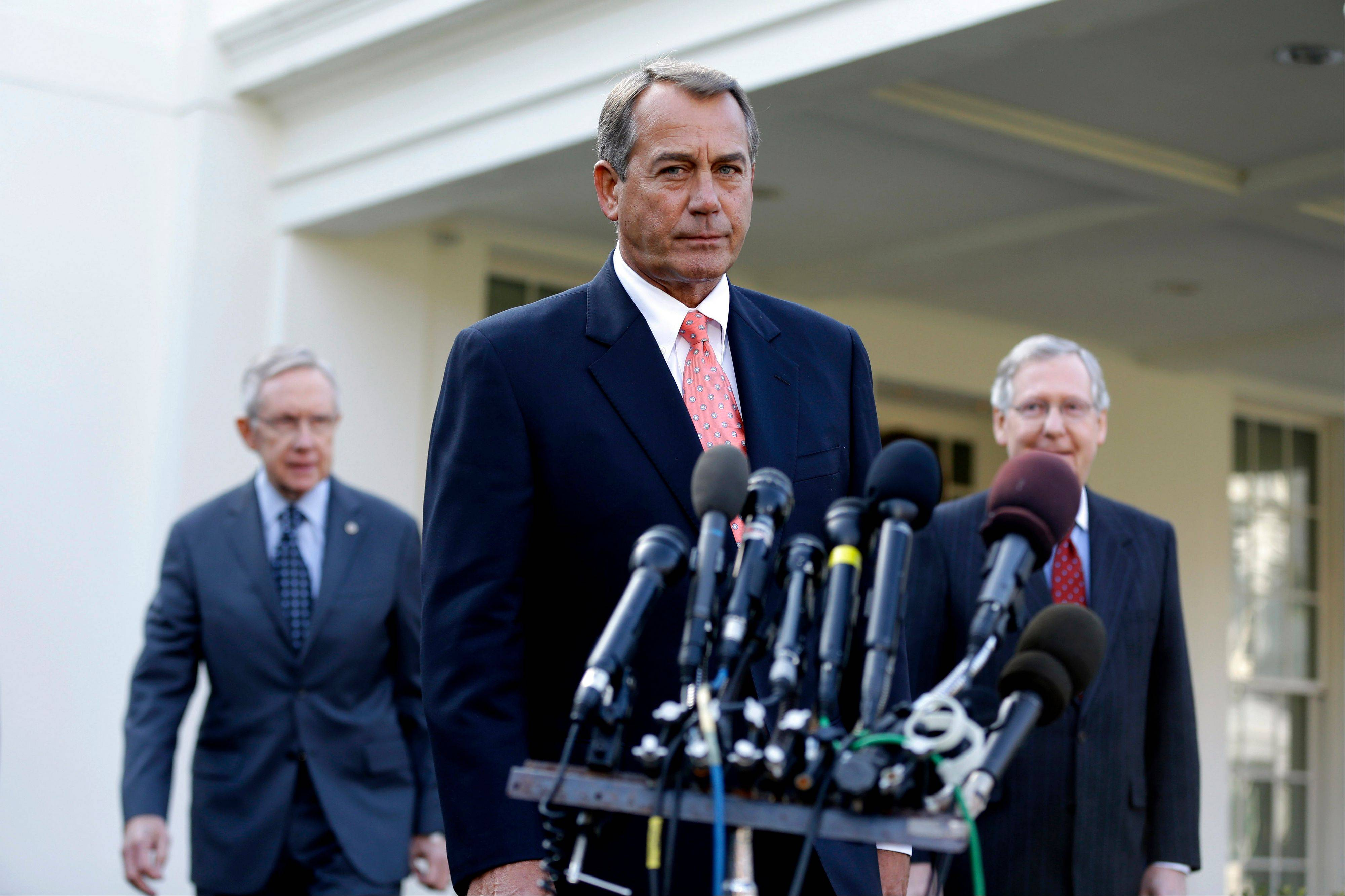 House Speaker John Boehner of Ohio, center, followed by Senate Majority Leader Harry Reid of Nev., left, and Senate Minority Leader Mitch McConnell of Ky., approaches the the microphones Friday outside the White House.