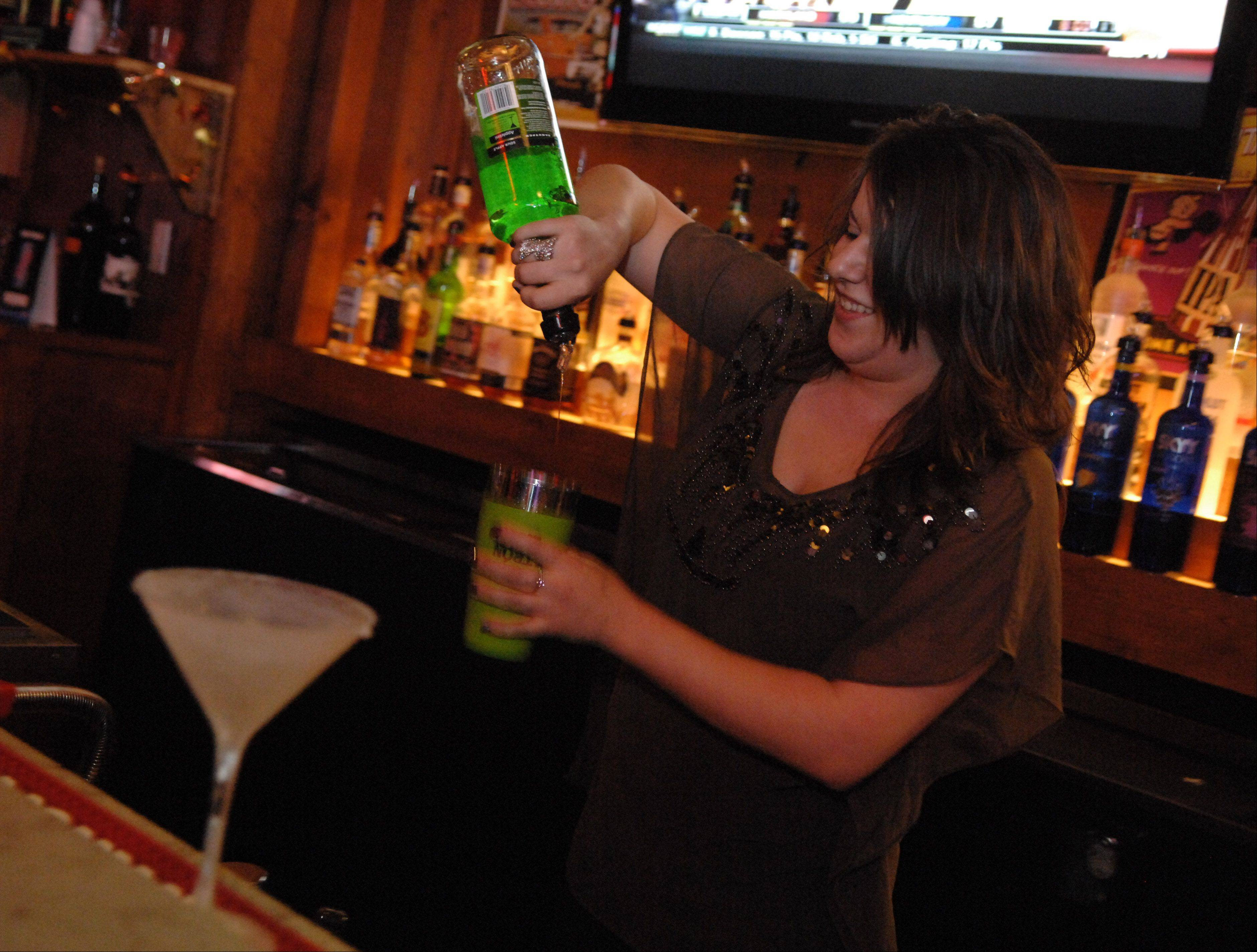 Bartender Annie Myers pours a cocktail at Prairie Rock Bar & Grill in Elgin.