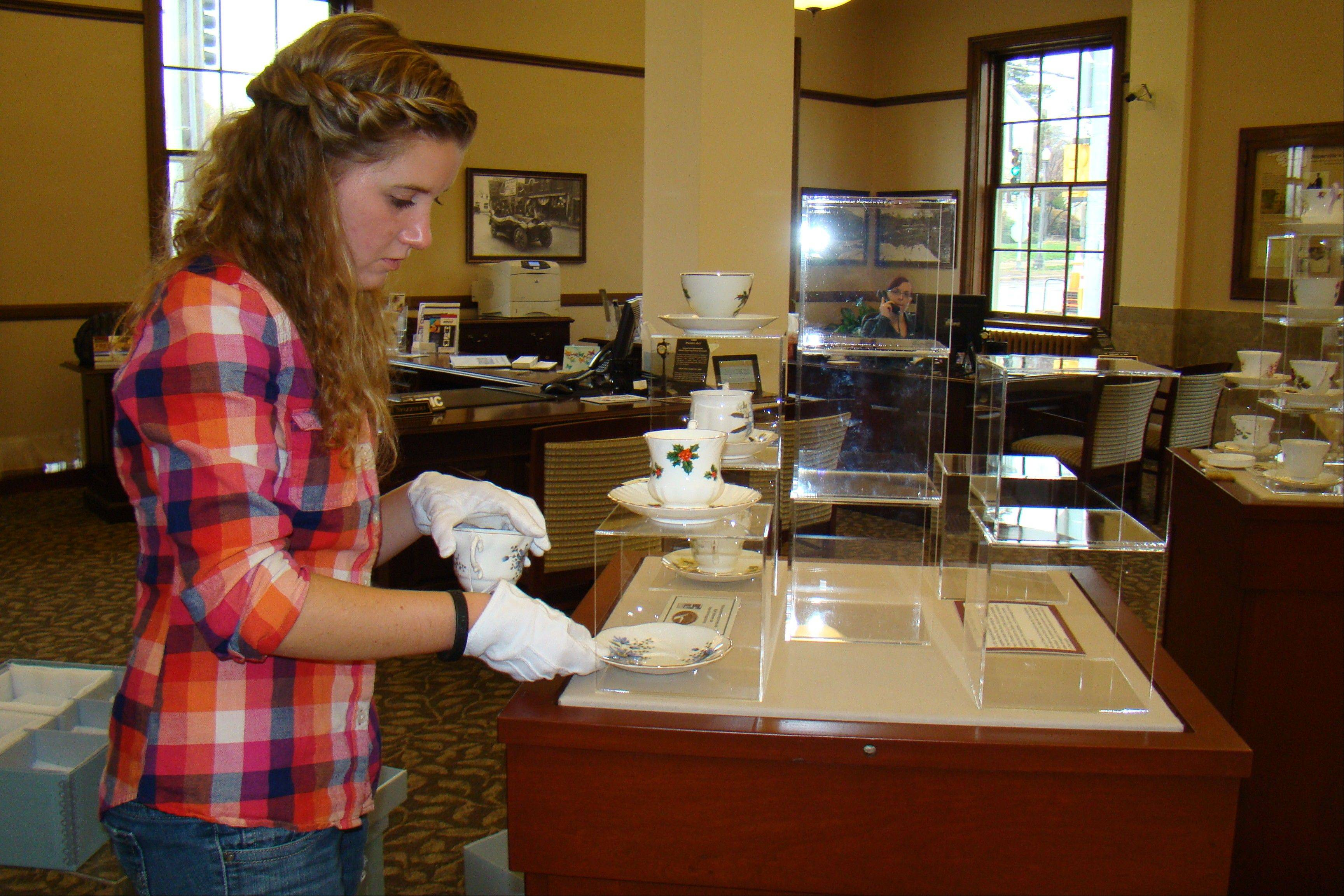Tiffany Tindell, a sophomore at North Central College, researched and chose all the teacups and saucers for the Cup of Cheer exhibit.