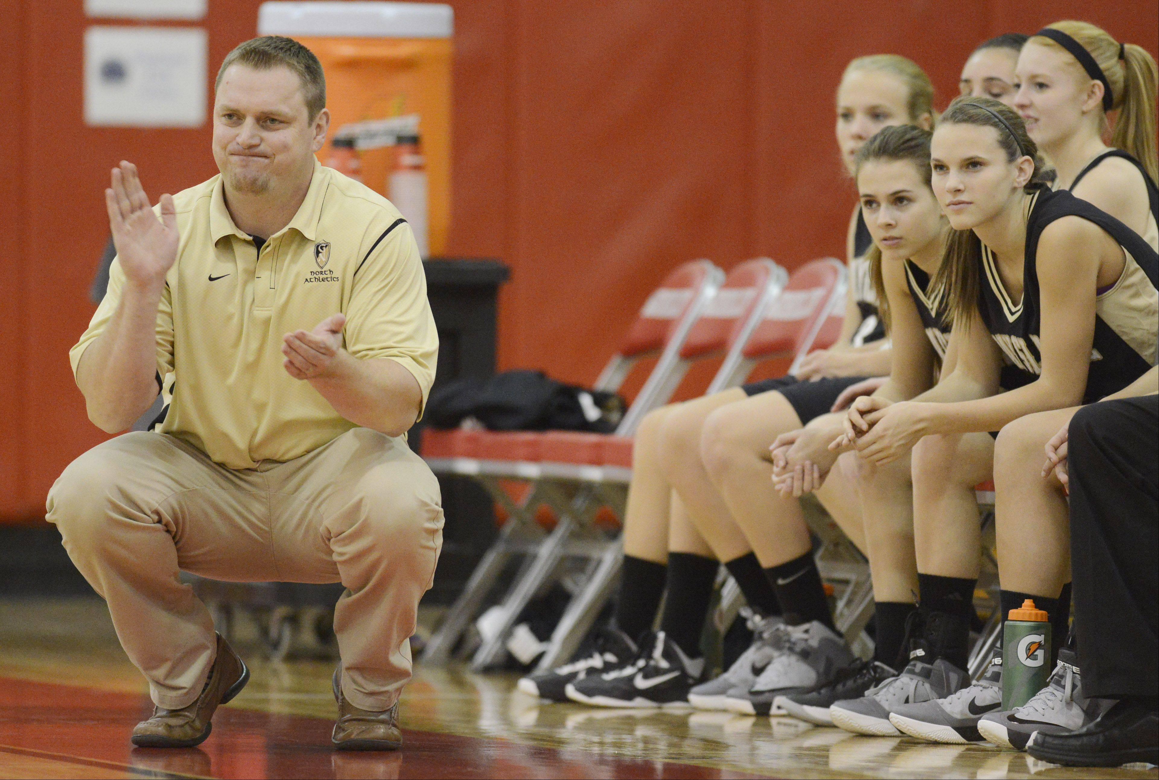 Grayslake North coach Nate Flannery leads his team during Friday�s game against Prairie Ridge.