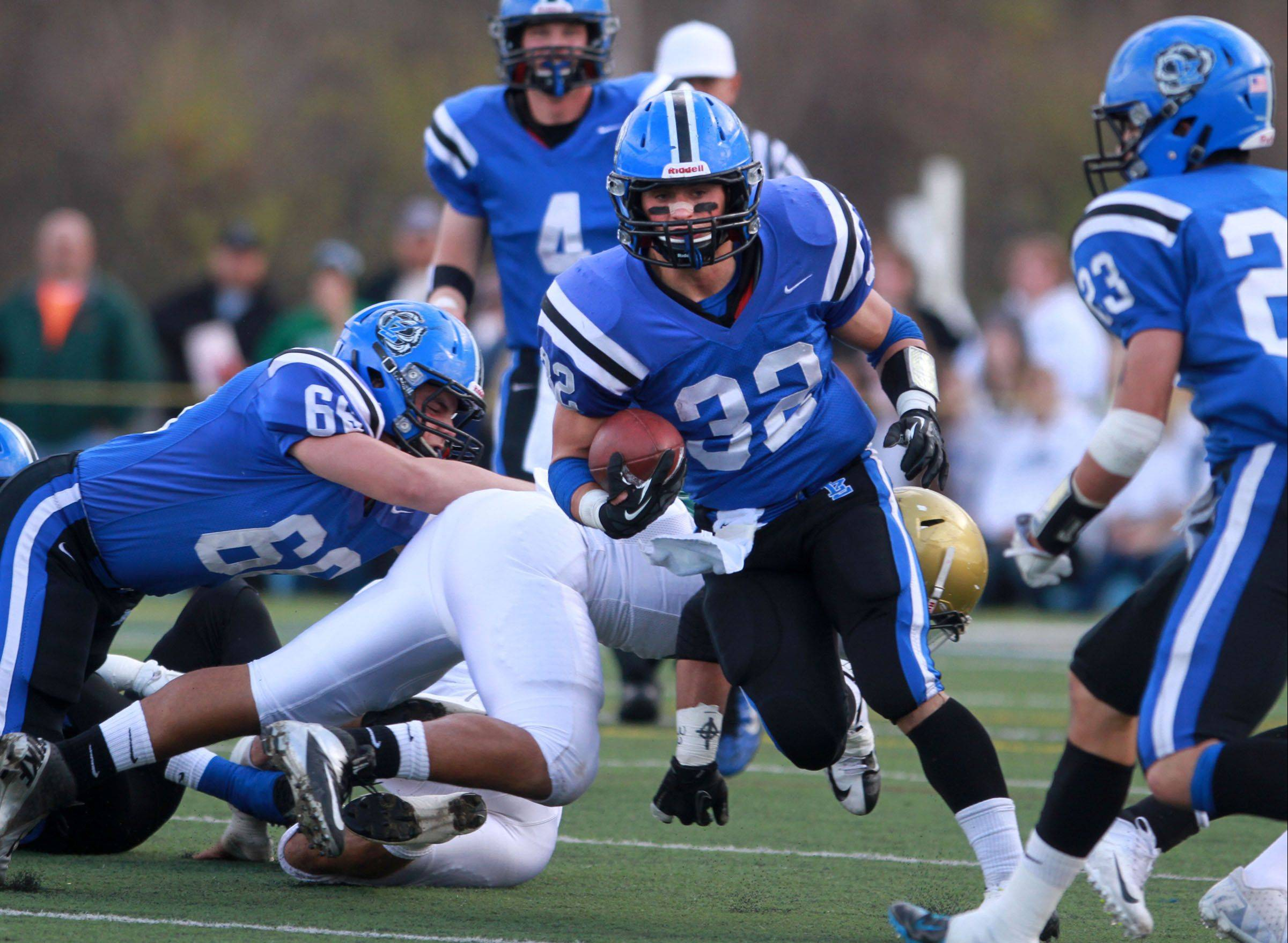 Lake Zurich running back Connor Schrader finds a hole against Rockford Boylan in last weekend�s Class 7A state quarterfinal game.
