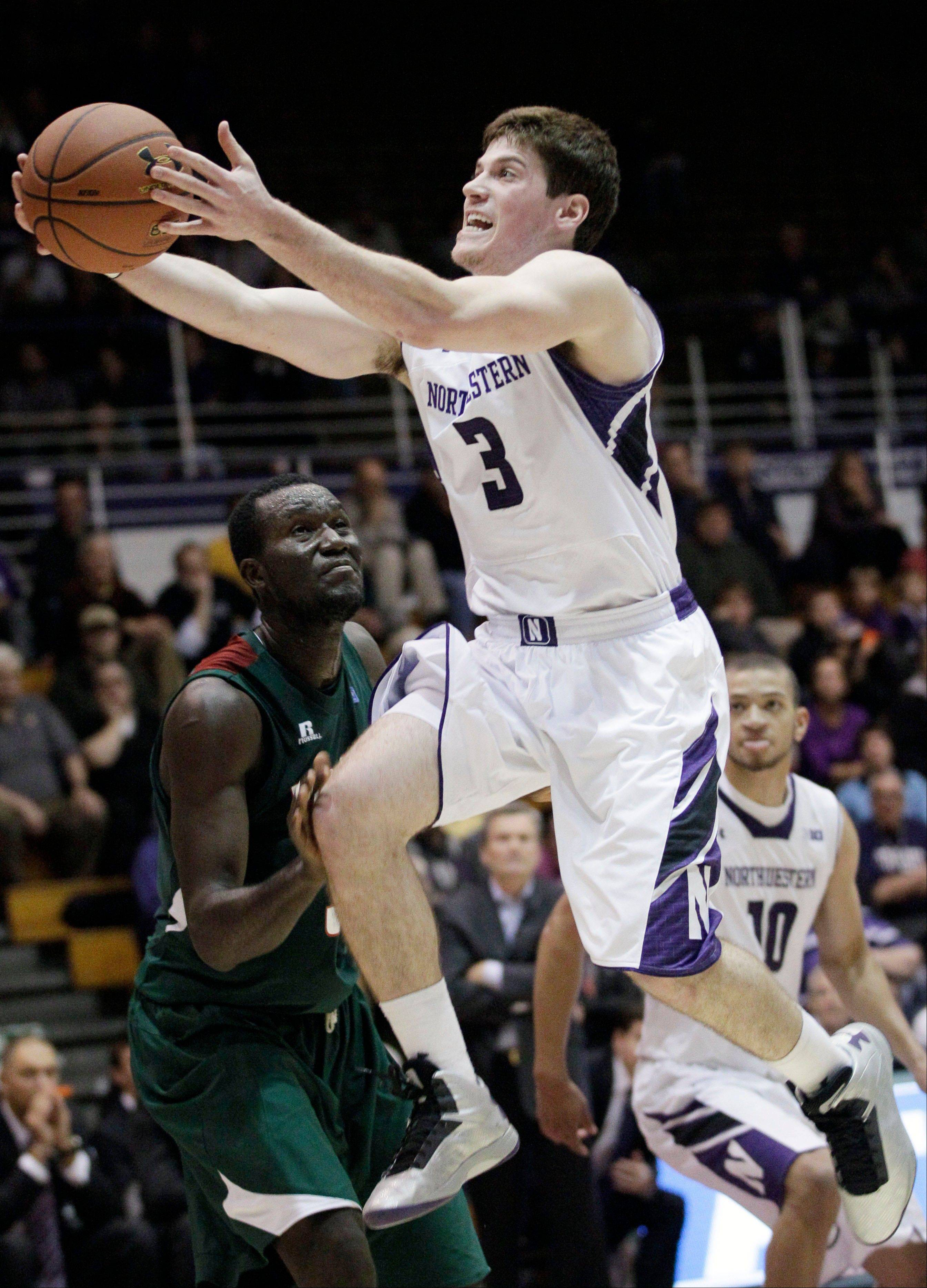 Northwestern guard Dave Sobolewski (3) drives to the basket as Mississippi Valley State center Julius Francis during the second half of an NCAA college basketball game in Evanston, Ill., on Thursday, Nov. 15, 2012. Northwestern won 81-68. (AP Photo/Nam Y. Huh)