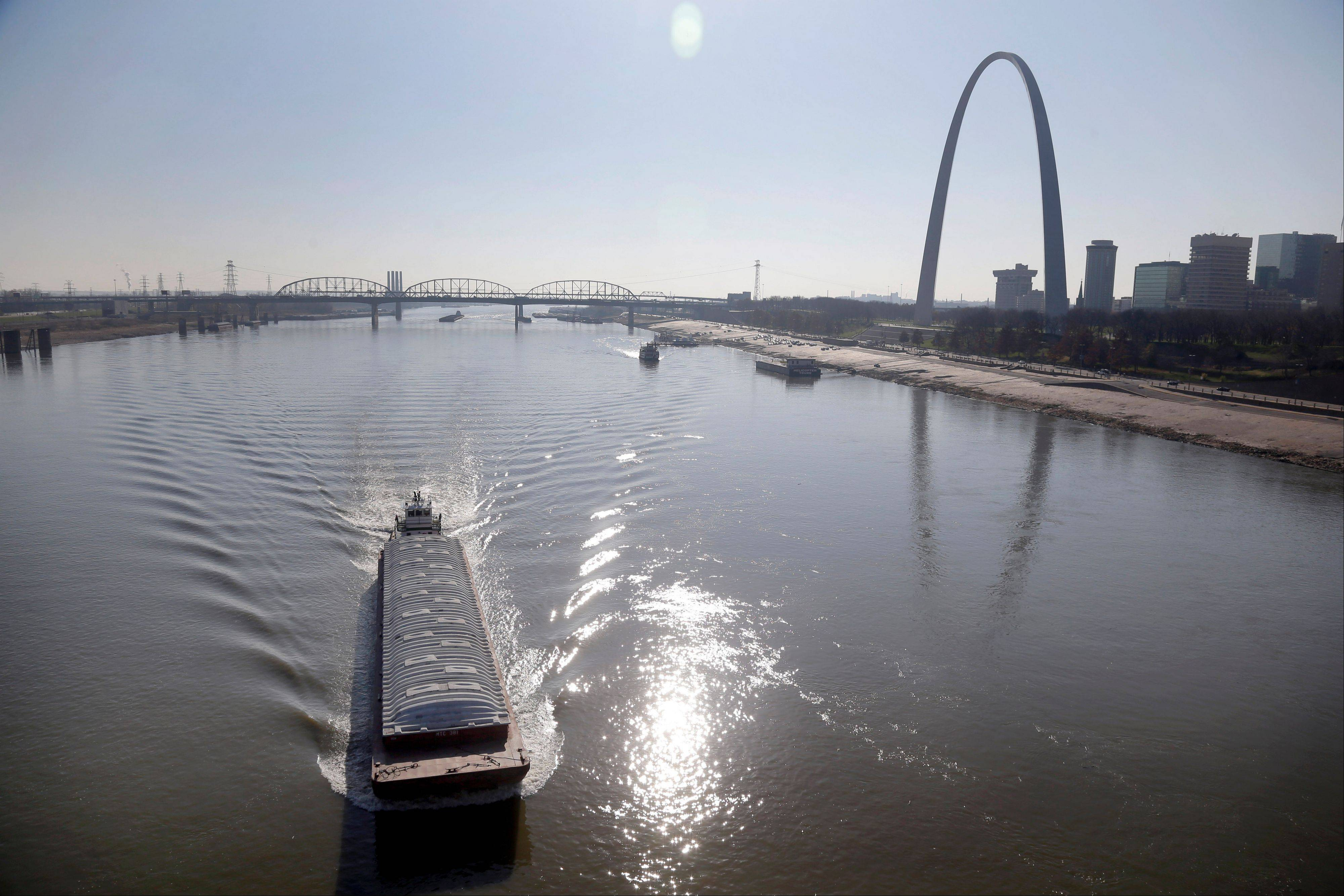 A barge powers its way up the Mississippi River Friday, in St. Louis.