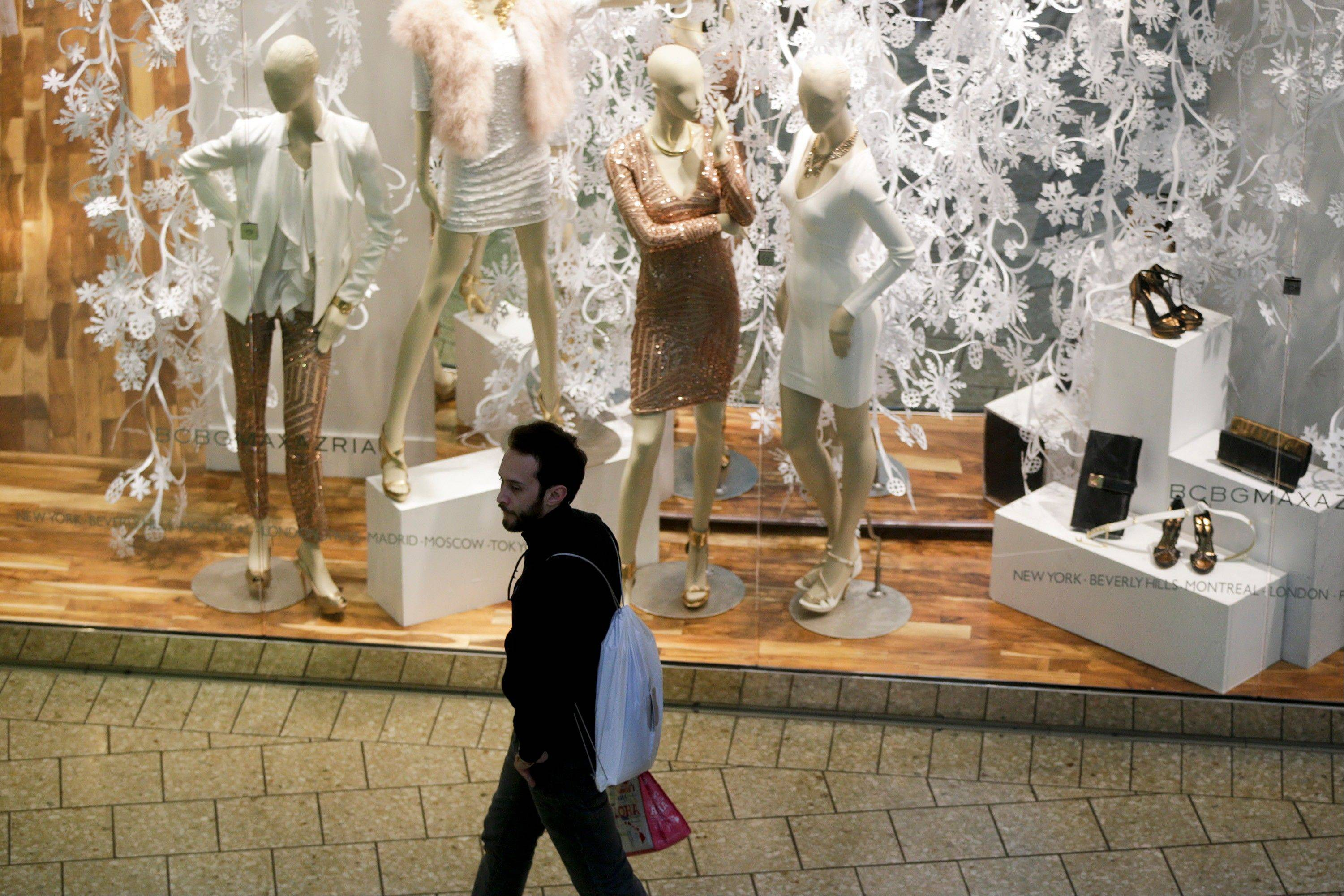 Bloomberg NewsA man carrying an Apple Inc. shopping bag walks past a BCBG Max Azria Group Inc. store Monday at the Fair Oaks Mall in Fairfax, Virginia, U.S. Apple has recently shown a willingness to settle some of its legal disputes.
