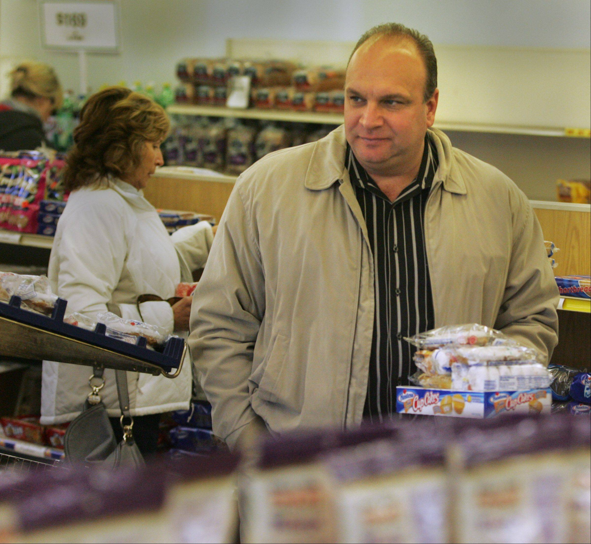 Gilberts resident Dave Scurto stopped into the Wonder Hostess Thrift Shop Friday afternoon to pick up some treats after he heard the store would be closing.