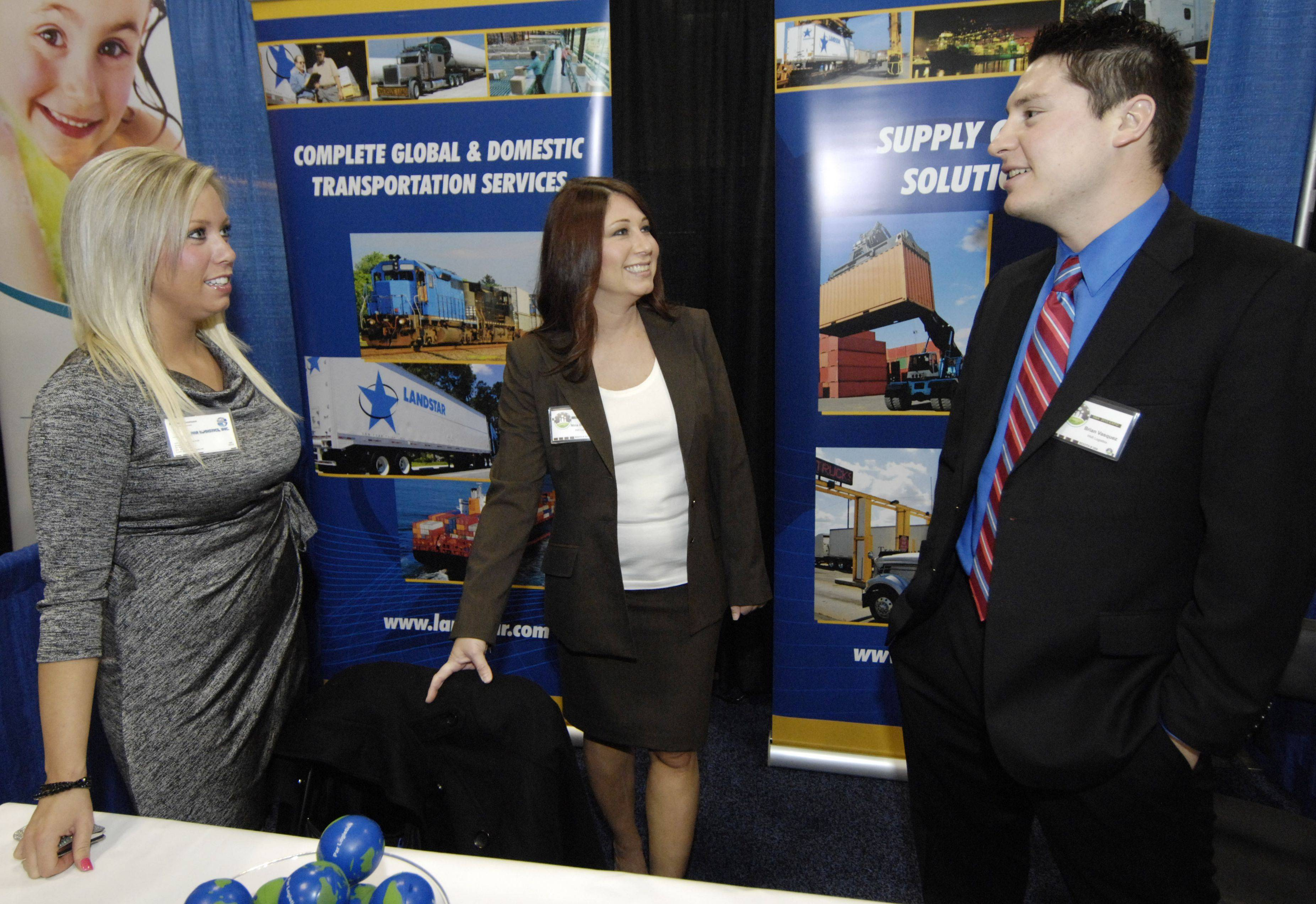Amanda Thomsen, from left, Nina Bongiovanni and Brian Vasquez staff the Par Logistics booth during the Schaumburg Business Association business expo at the Renaissance Schaumburg Convention Center.