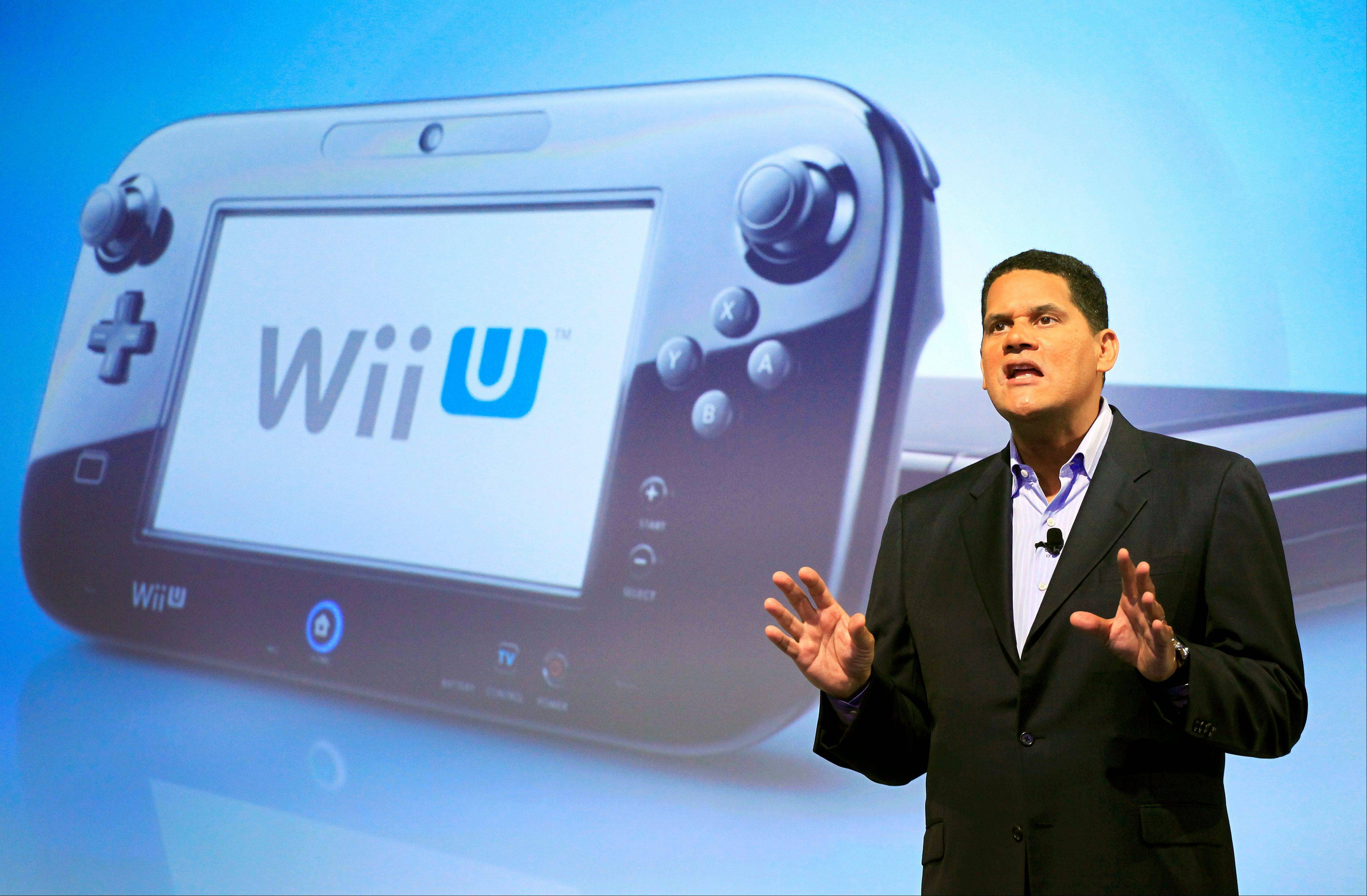 Reggie Fils-Aime, president and chief operating officer of Nintendo of America, discusses the upcoming Wii U gaming console in New York. Much like the iPad, the curvey GamePad for the new Wii U features a touch-screen that can be manipulated with the simple tap or swipe of a finger. The gaming console will start at $300 and go on sale in the U.S. on Sunday, Nov. 18.