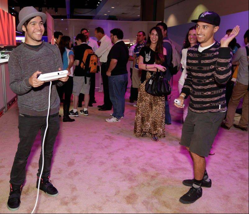 Pete Wentz, left, and guests play Nintendo's Wii U during E3 in Los Angeles in June.