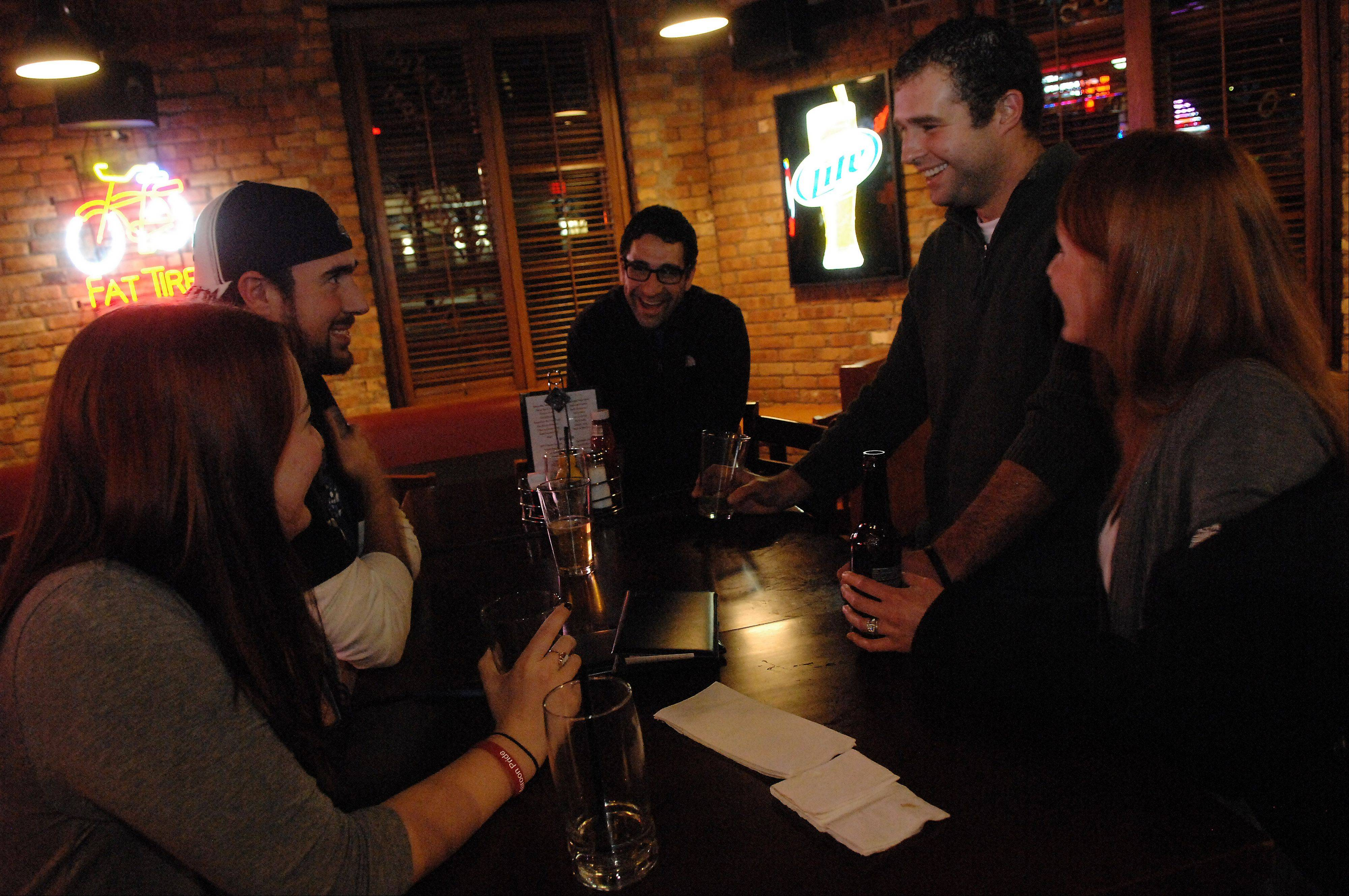 Friends Sally Lennon, left, of Arlington Heights, Dan Barsotti of Palatine, Ruben Flores, and Kyle and Brenna Molik, all of Elgin, enjoy some drinks at Prairie Rock Bar & Grill in Elgin.