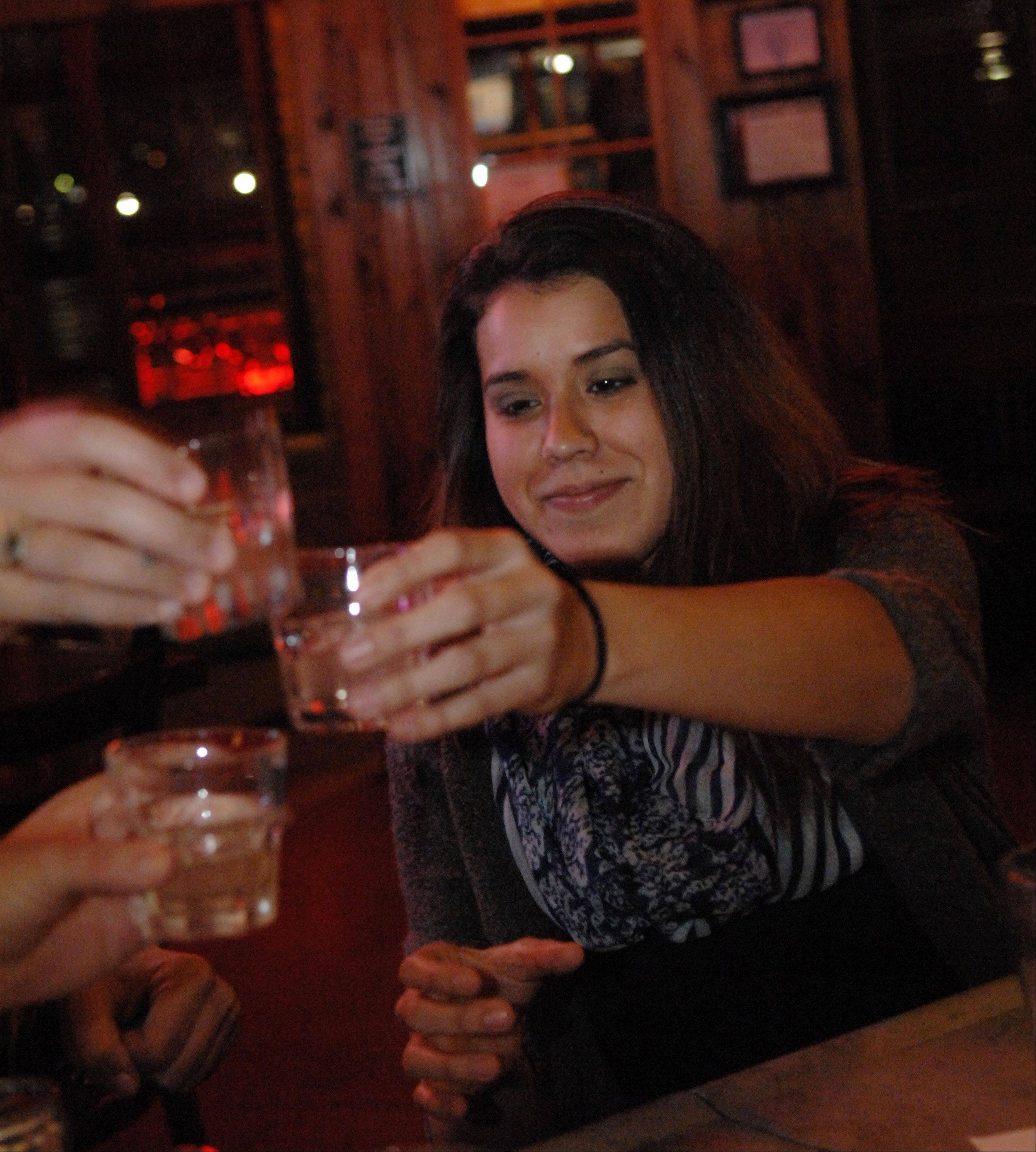 Jena Villarreal of Elgin toasts with shots at Prairie Rock Bar & Grill in Elgin.