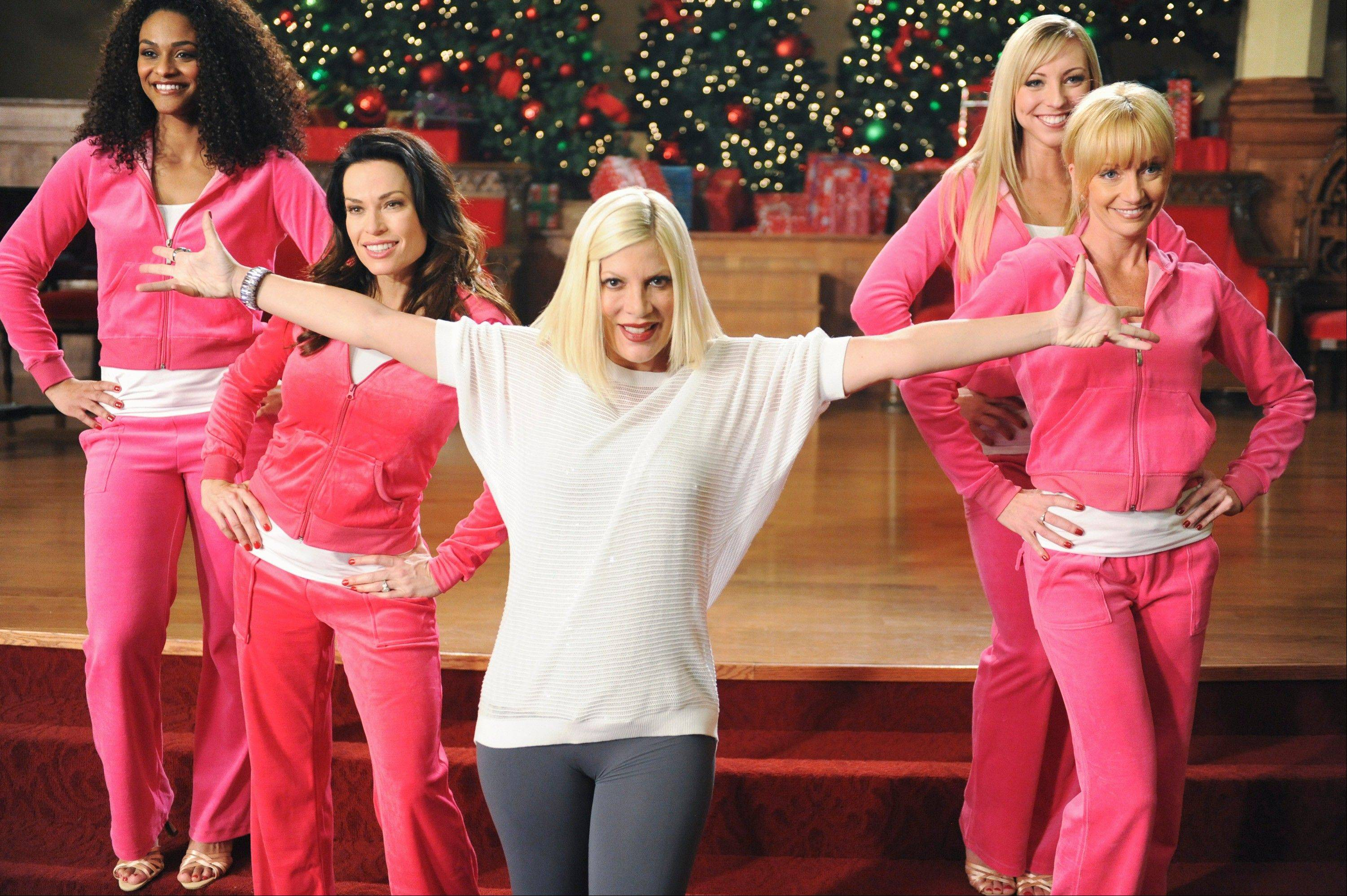 "Tori Spelling, center, stars in the ABC Family holiday musical, ""The Mistle-Tones,"" at 7 p.m. Sunday, Dec. 9."