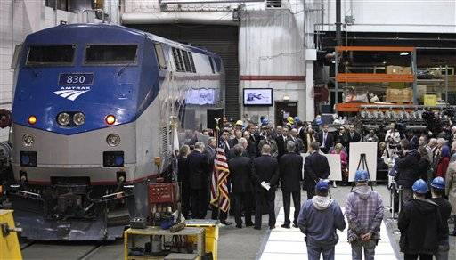 In this March 22, 2011 file photo, Illinois Gov. Pat Quinn and U.S. Sen. Dick Durbin are joined by state and local officials as they announce the next phase of high-speed rail construction during a news conference at an Amtrak maintenance building in Chicago.