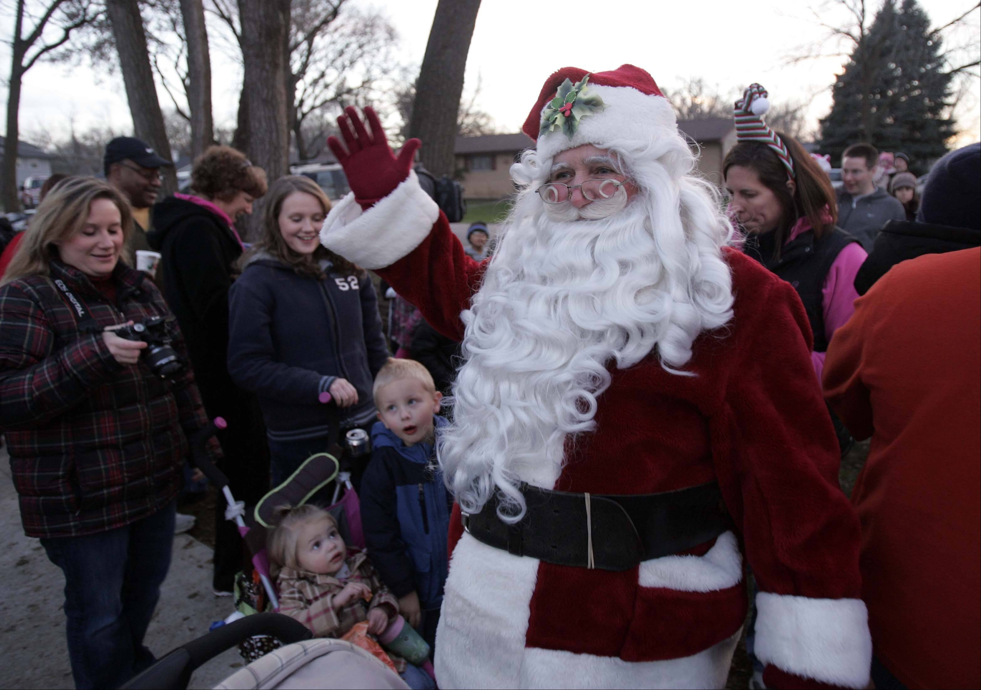 "Santa waves to the crowd after arriving at Saturday's ""An Almost Winter Day"" at SEBA Park in South Elgin."