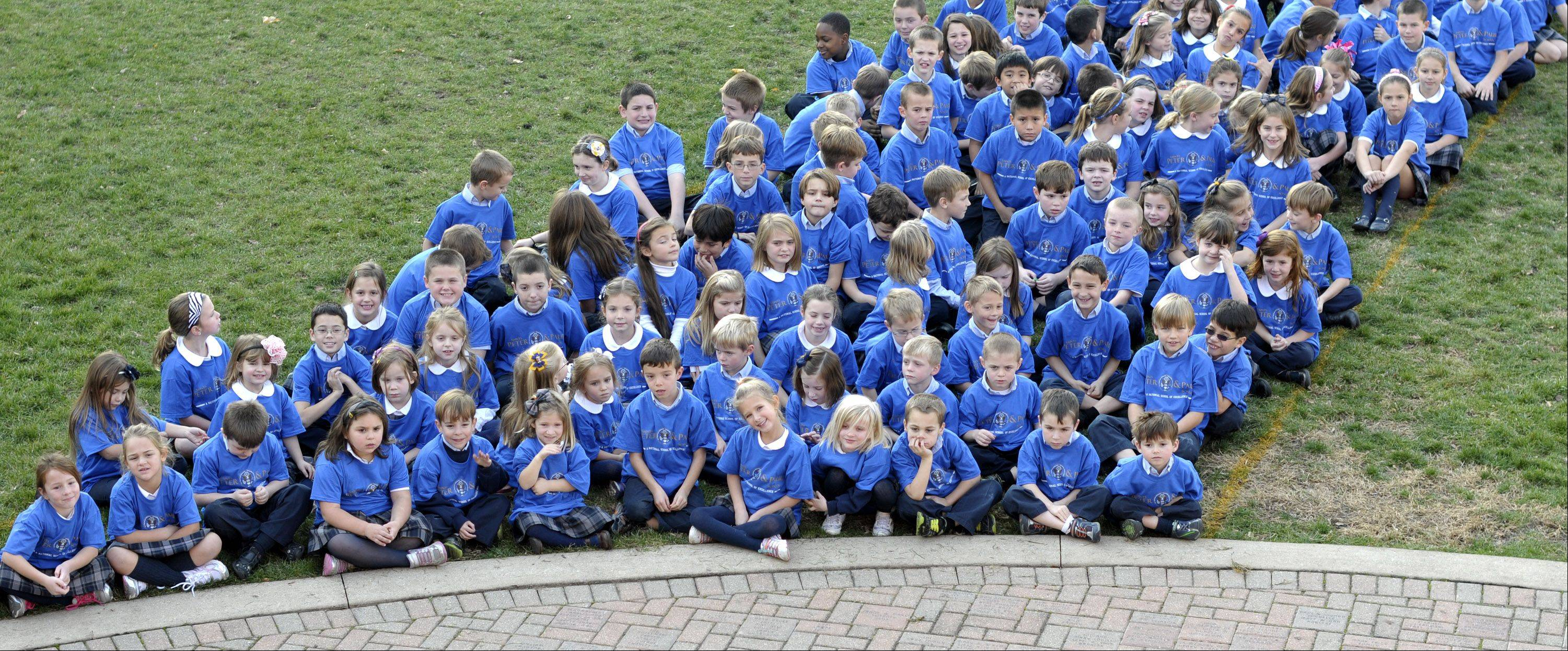 Ss. Peter and Paul School students formed a sea of blue Friday, all wearing special T-shirts commemorating the school's Blue Ribbon School status.